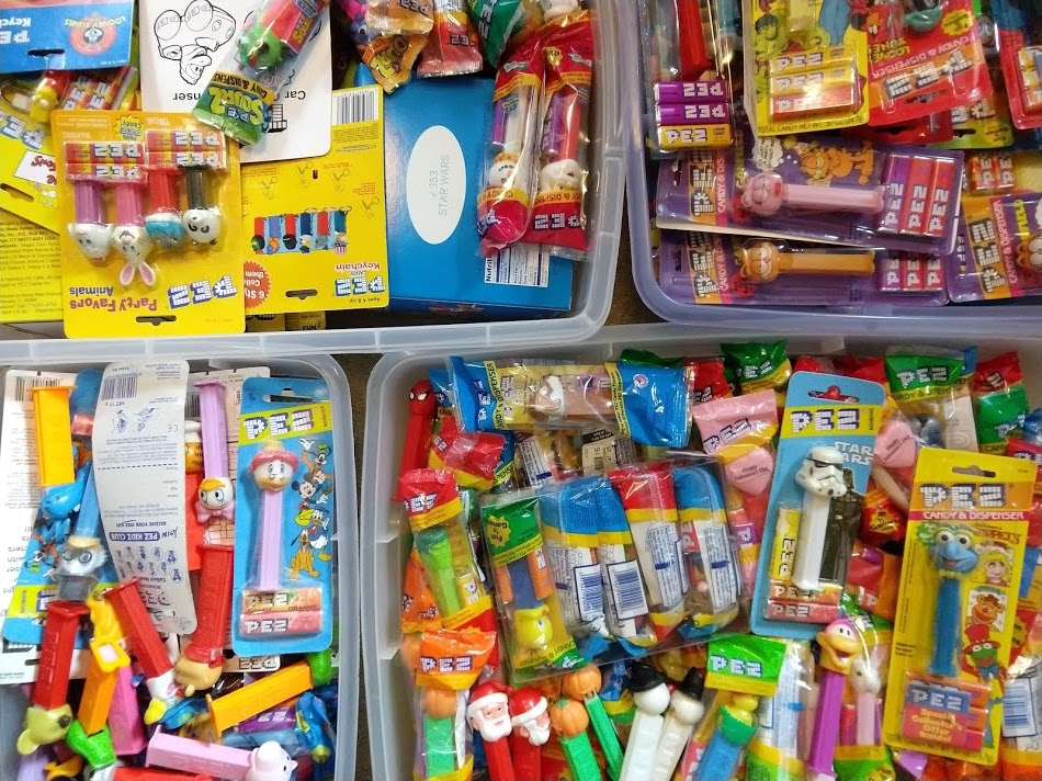 Some of the chaos that is my own collection. PEZ collectors don't seem to care if the dispenser is still in its original packaging, but I play it safe. That candy must be disgusting by now.