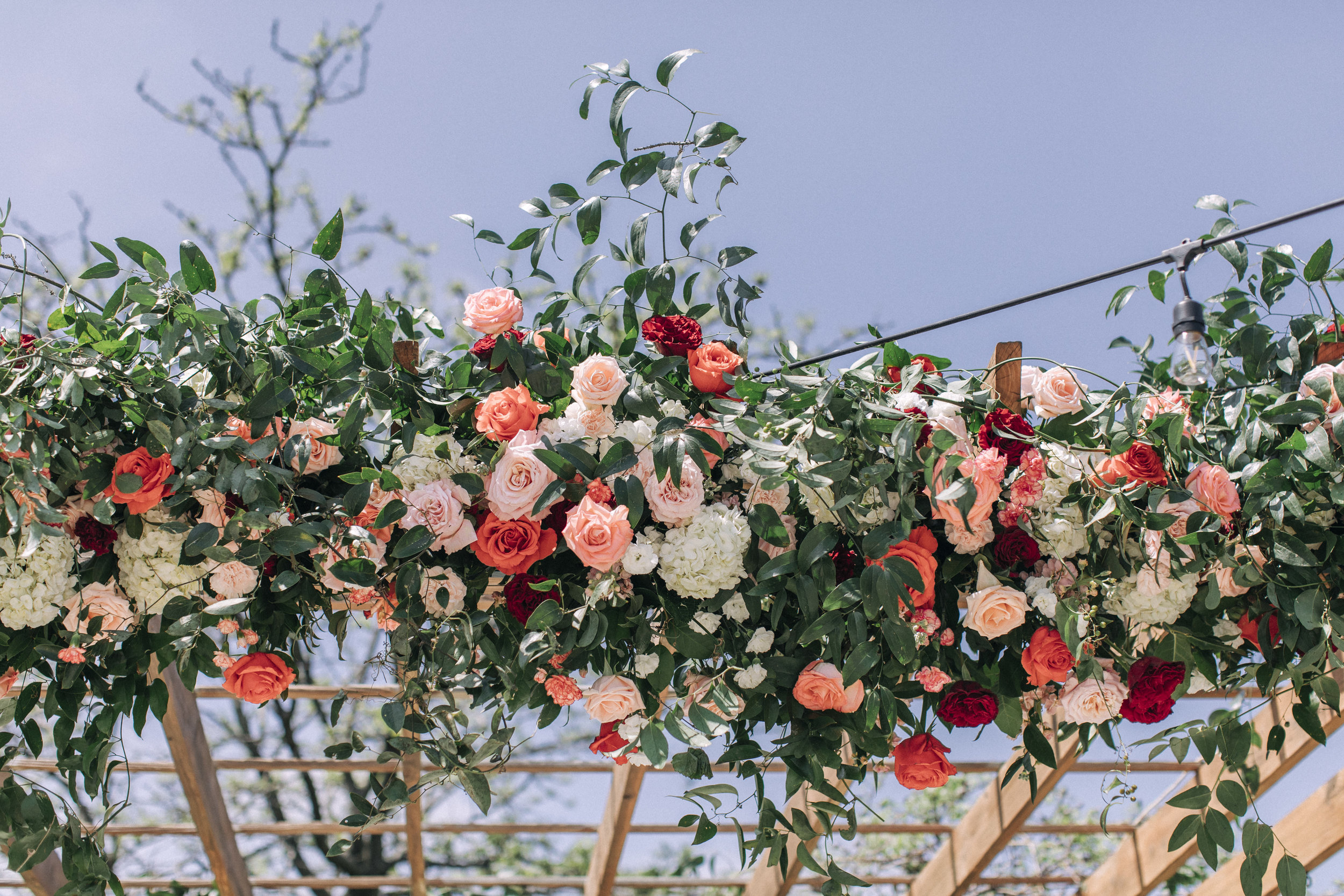 Mandap with white, peach, blush, orange, coral, burgundy