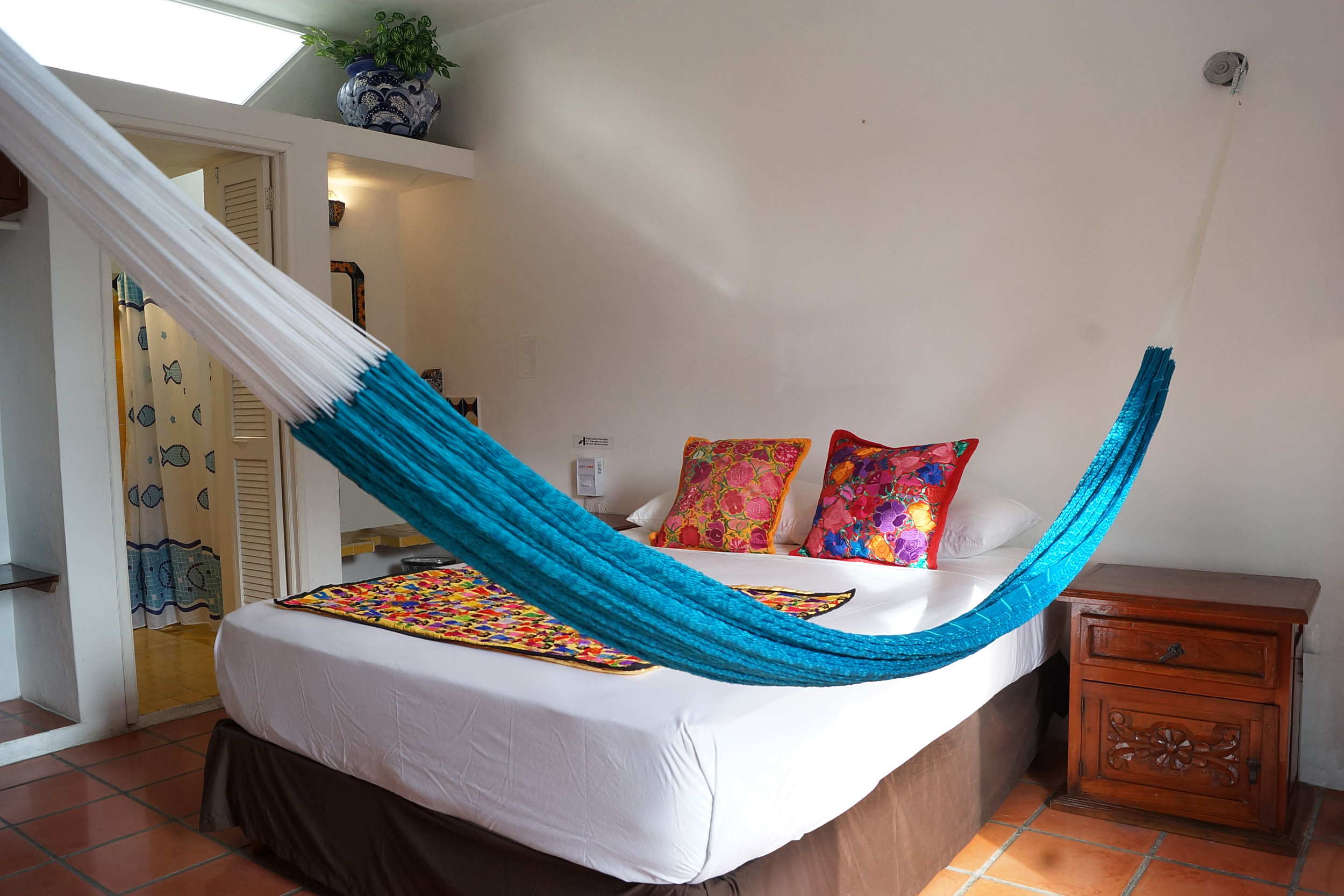 TAMARINDO BED AND BREAKFAST - This highly ranked B&B is set among tranquil, tropical gardens and palapa roofs, offering privacy and relaxed surroundings. Furnished with vibrant local decor alongside luxury accommodations, guests have called Tamarindo their home in Cozumel for over 20 years!Tamarindo B&B is only 4 blocks from the oceanfront in Zona Centro, near the ferry building and main square! The Cozumel International Airport is just minutes away by taxi. A full renovation of Tamarindo was completed in 2017 - Come experience the 5-star difference.