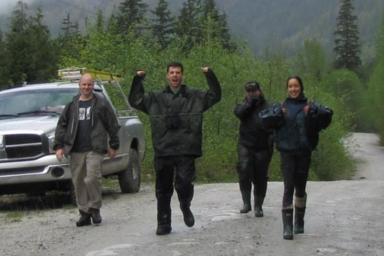 Ecstatic team members celebrate finding a Screech-Owl nest