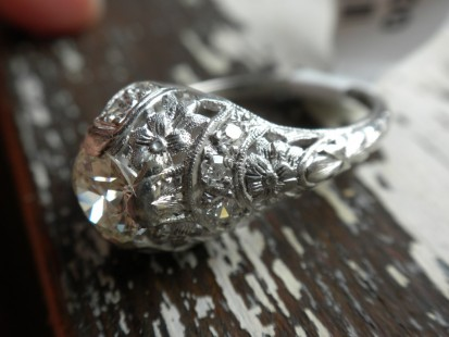 Ultra feminine floral motif vintage engagement ring