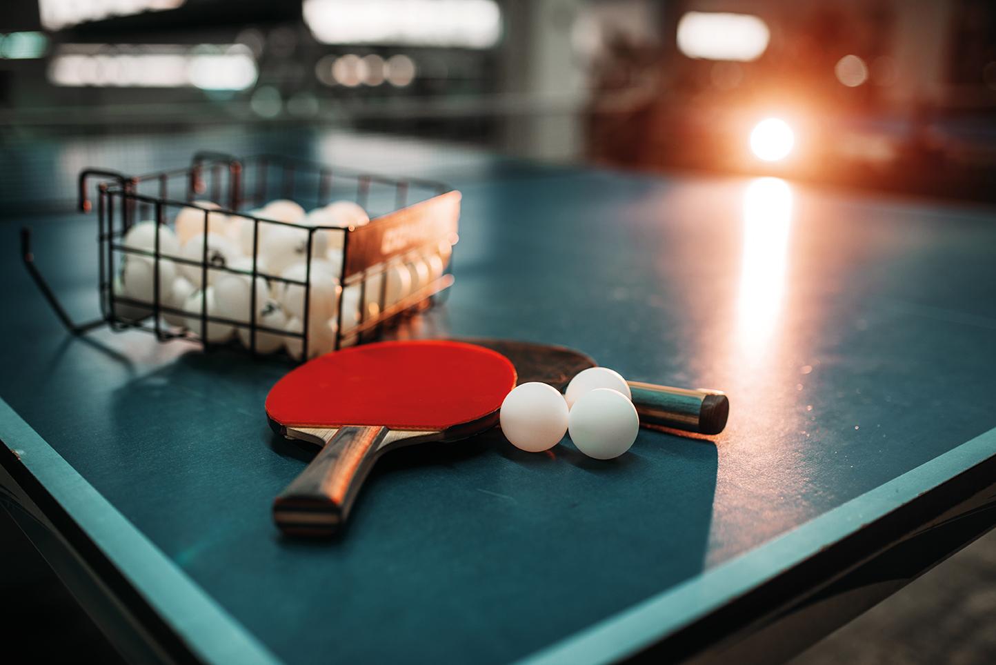 bigstock-Ping-pong-table-rackets-and-b-192379435.jpg