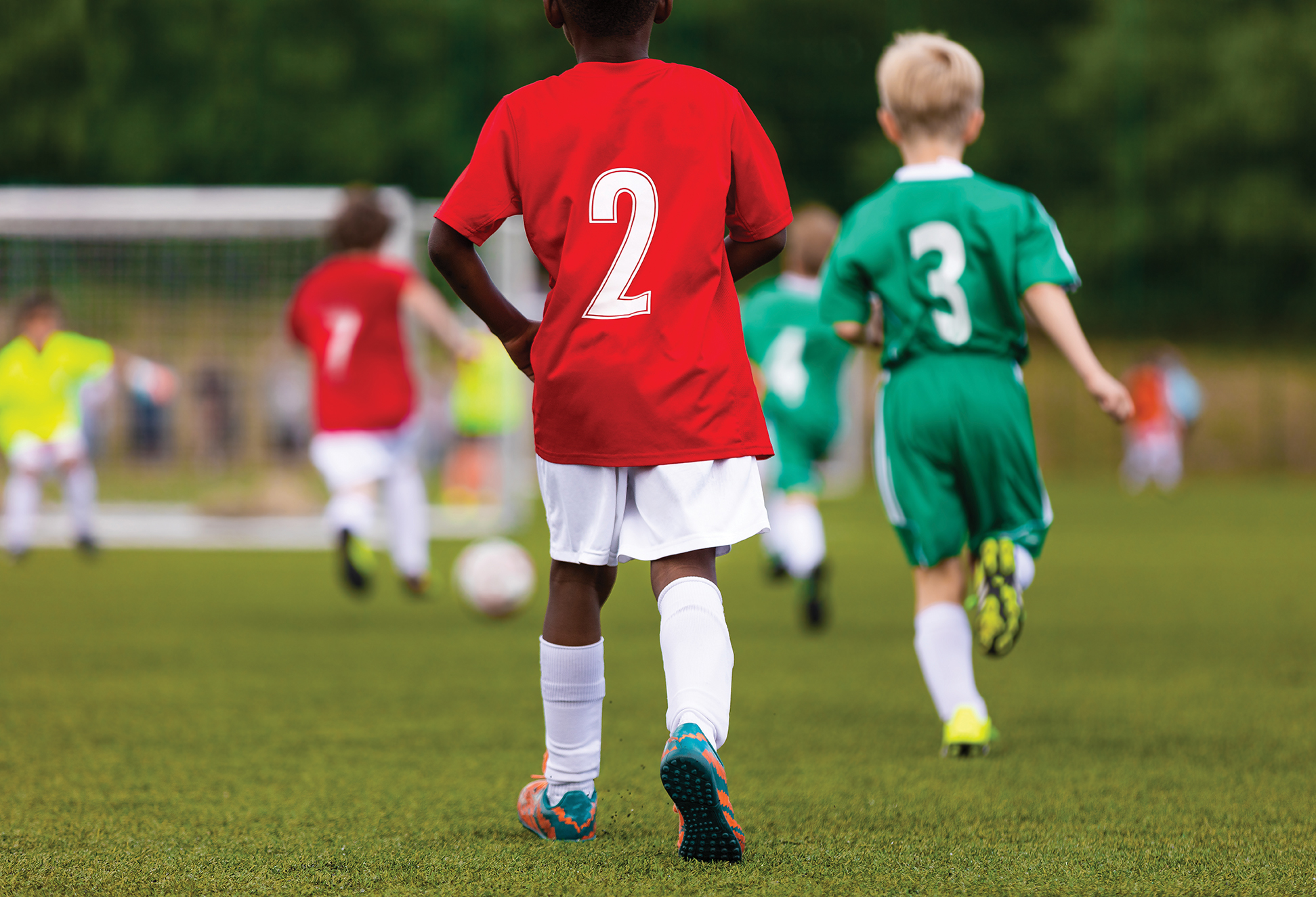 bigstock-Multiracial-Kids-Kicking-Footb-266830795.jpg