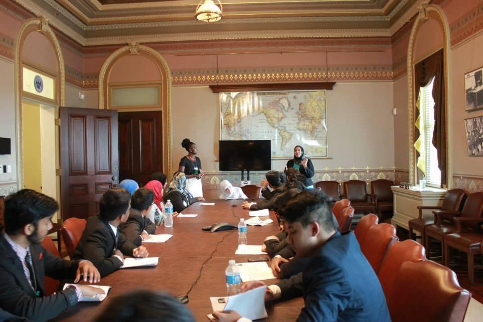 Ms. Mirza lecturing Maccpac fellows.