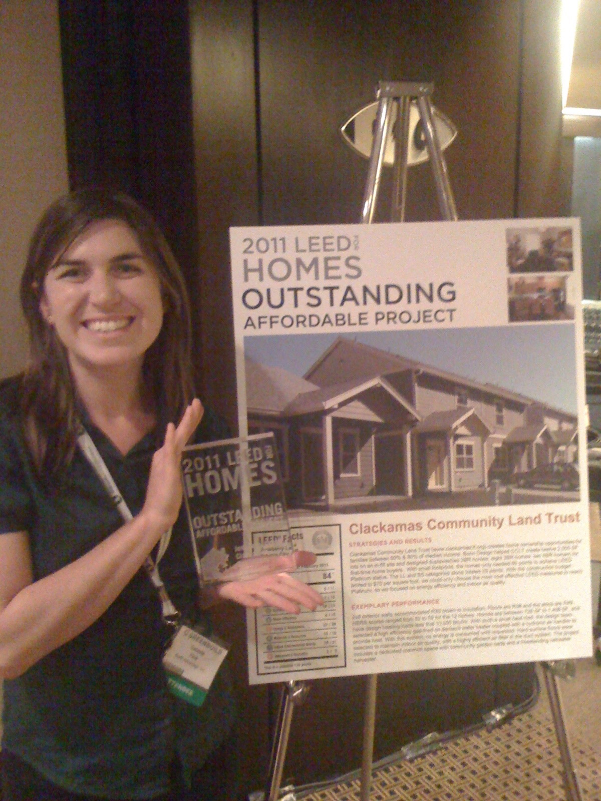 Receiving award at GreenBuild for completed project.