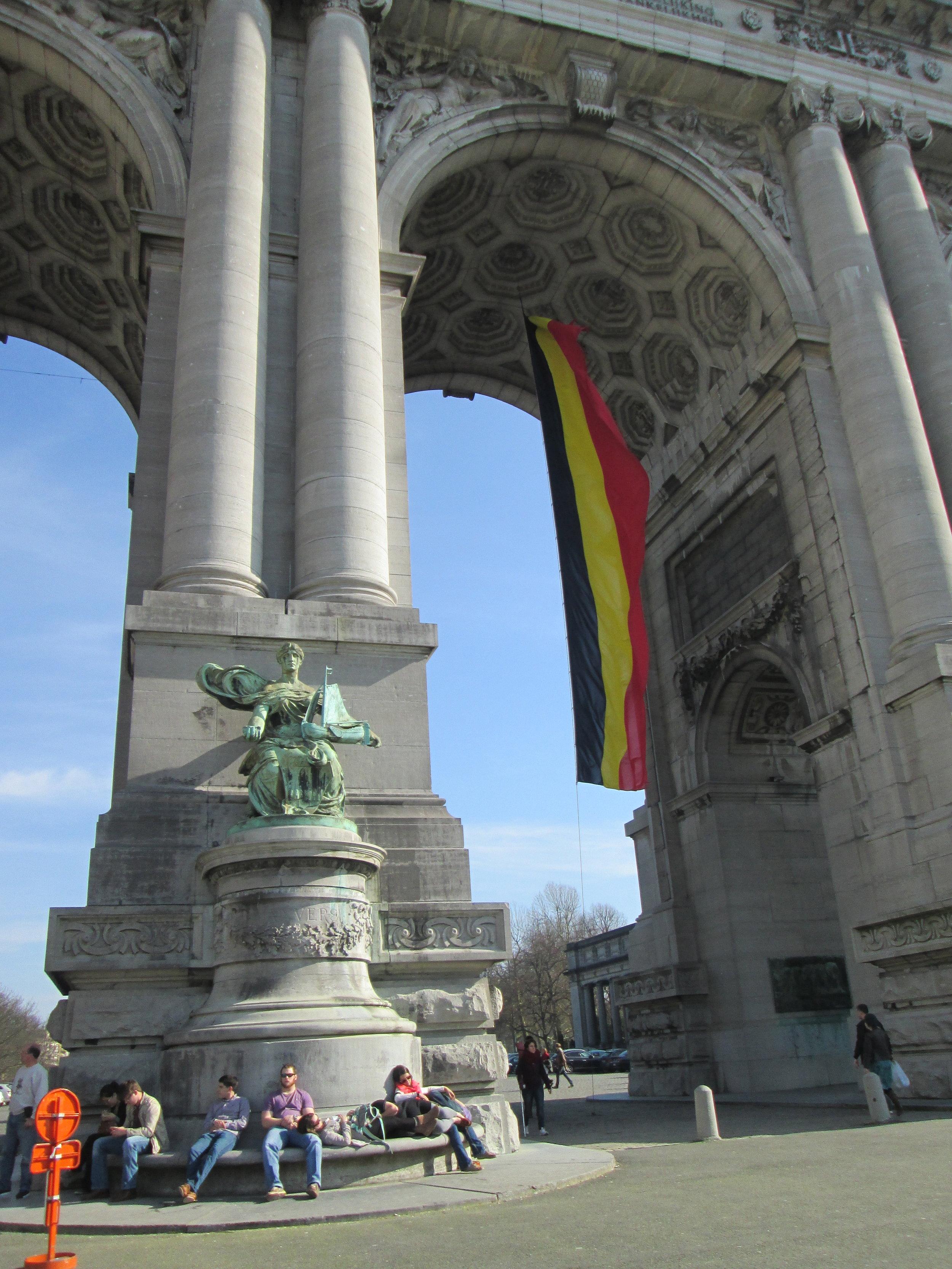 Arches at Parc du Cinquantenaire, complete with Belgian flag.
