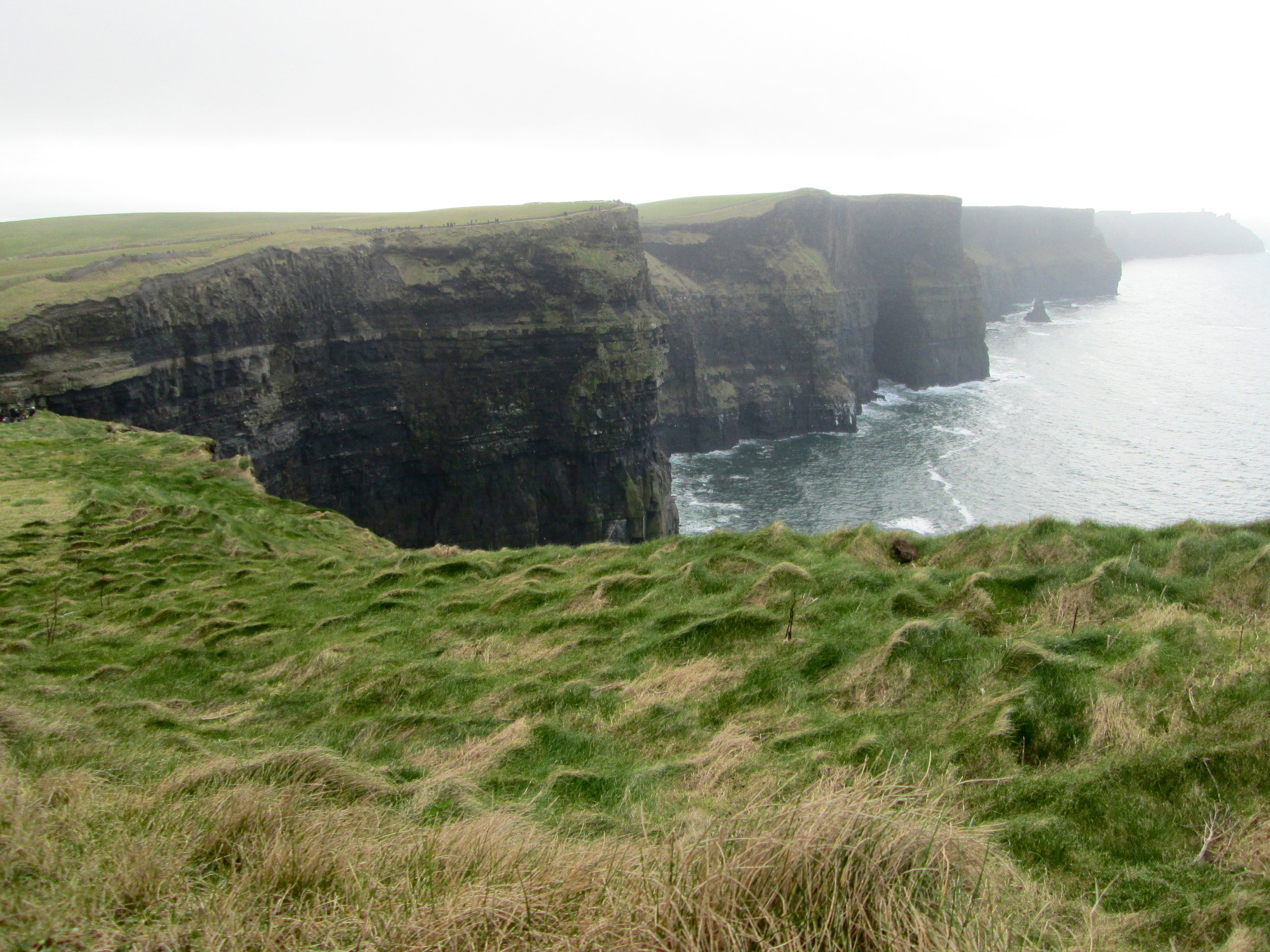 Fog rolling in over the Cliffs of Moher