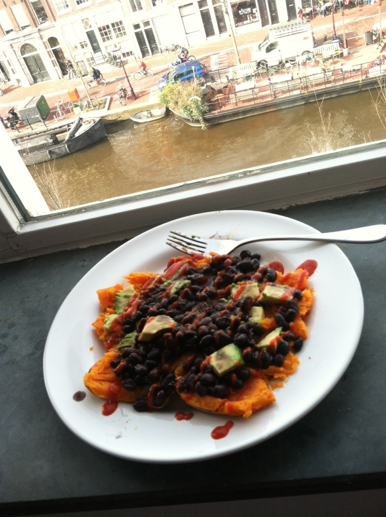 My staple lunch: Baked Sweet Potato, topped with Avocado, Black Beans and Sriracha.