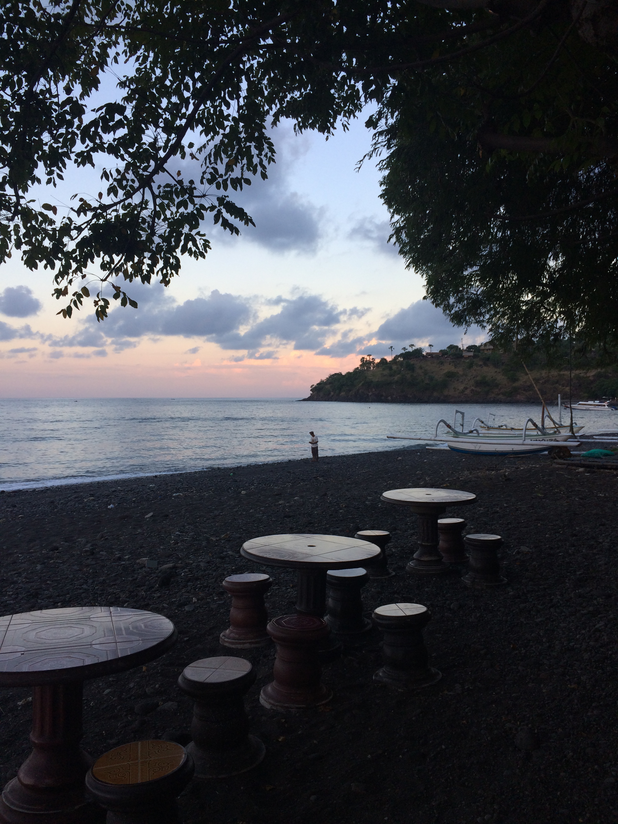 Sunset on Amed's black rock beaches.