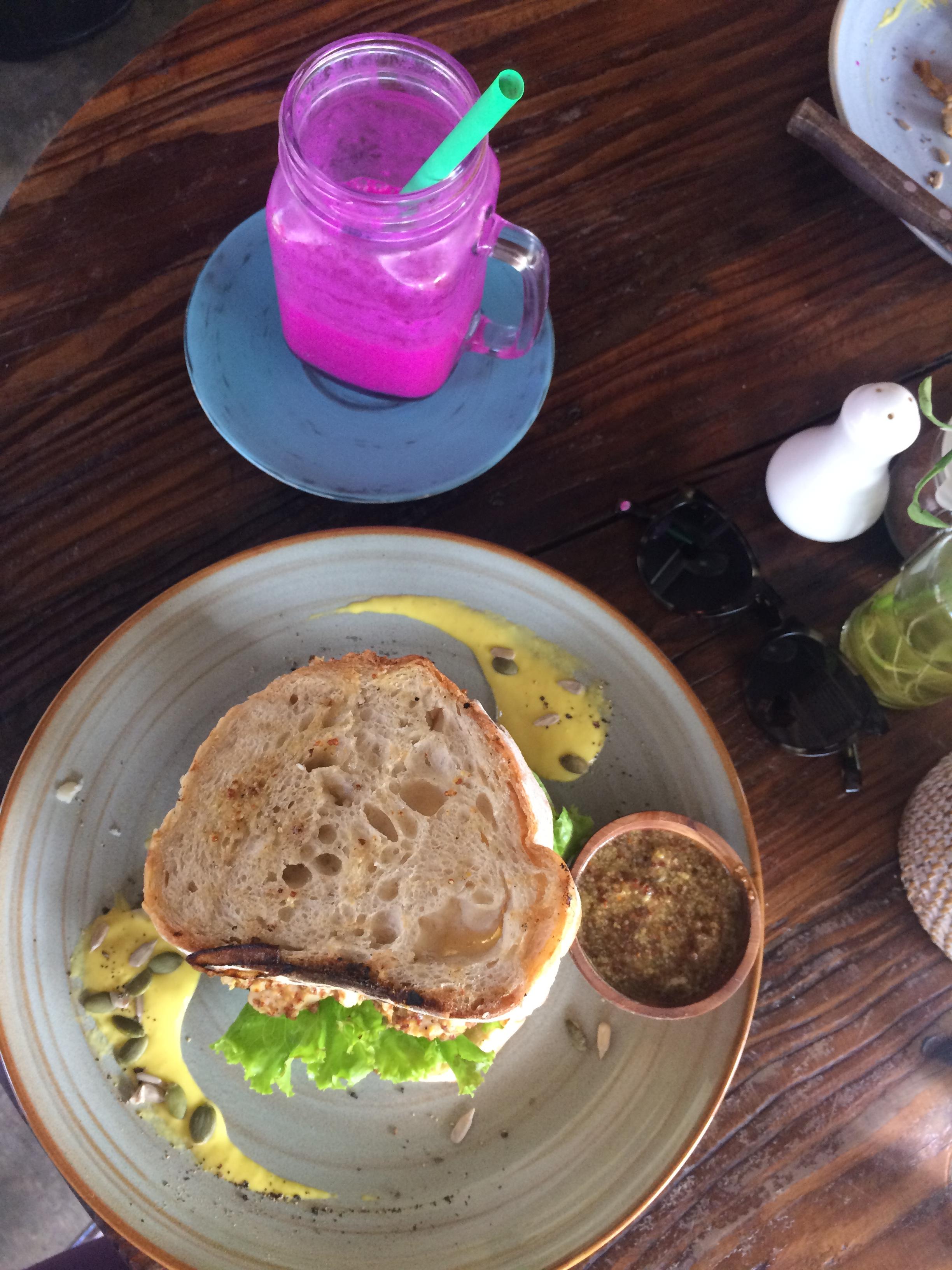 Dragonfruit smoothie and chicken sandwich from Sukka.