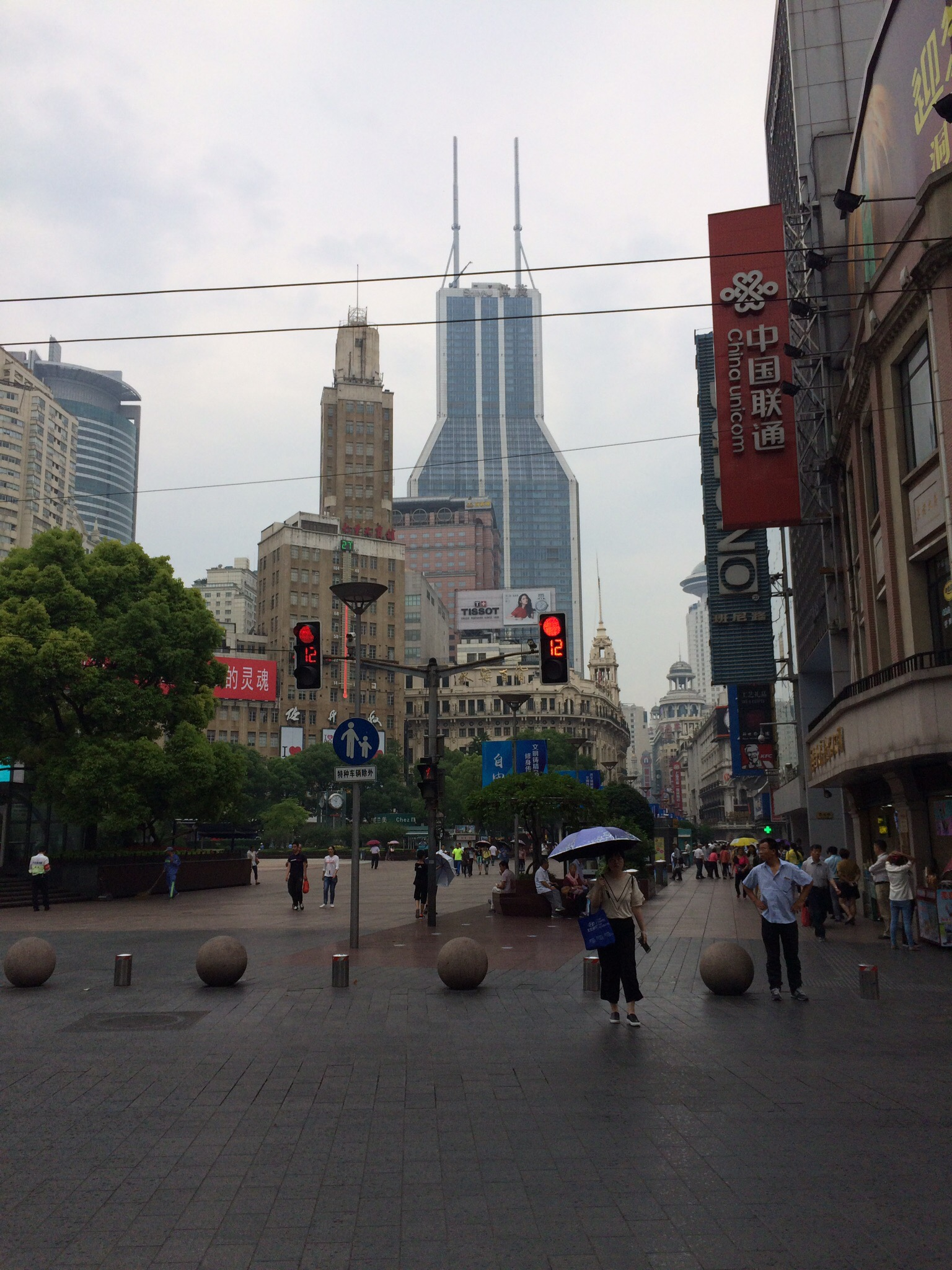 Walking down Nanjing Road in Shanghai, China.
