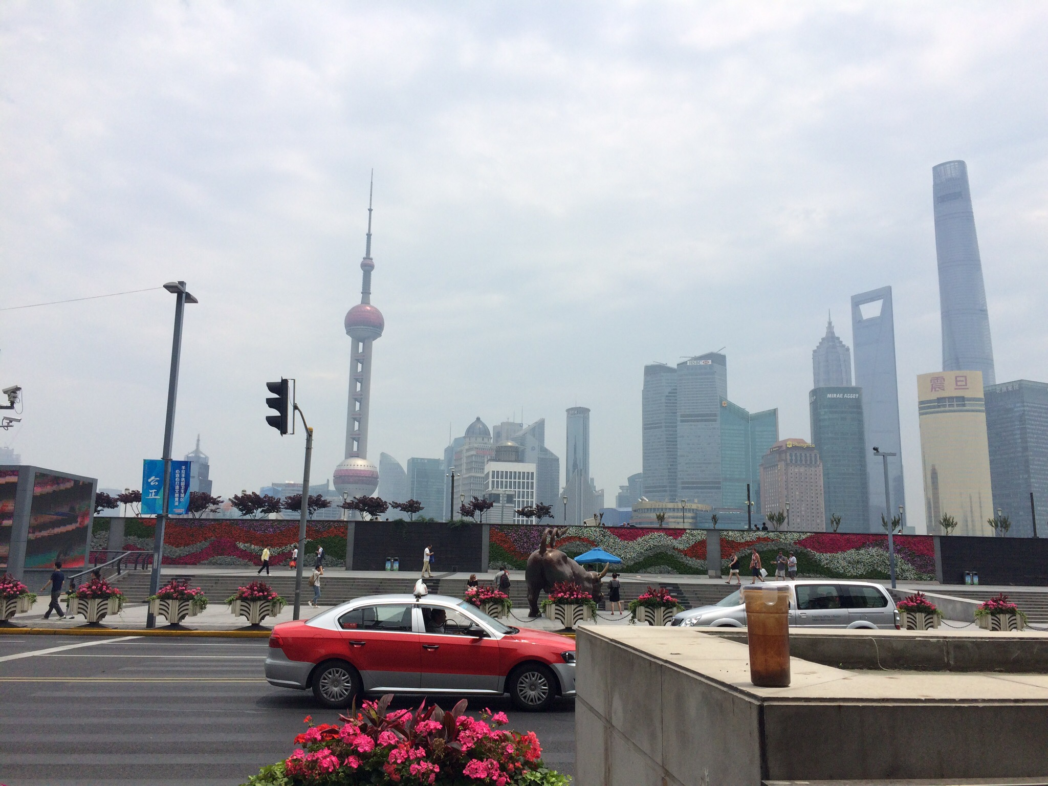 The bustle of the Bund against a backdrop of Shanghai's financial district.