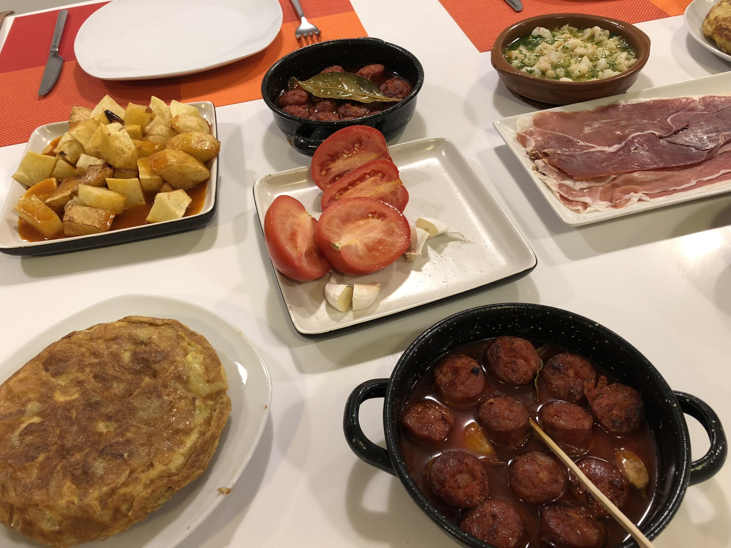 Culmination of our Spanish cooking class!Patatas Bravas, Marinated Chorizos, Garlic Shrimp, Iberico Ham, Tomato Bread, Spanish Omlette.