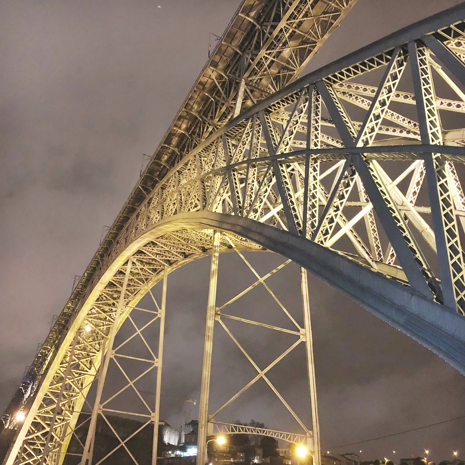 Walking under the Ponte Luis, all lit up at night.