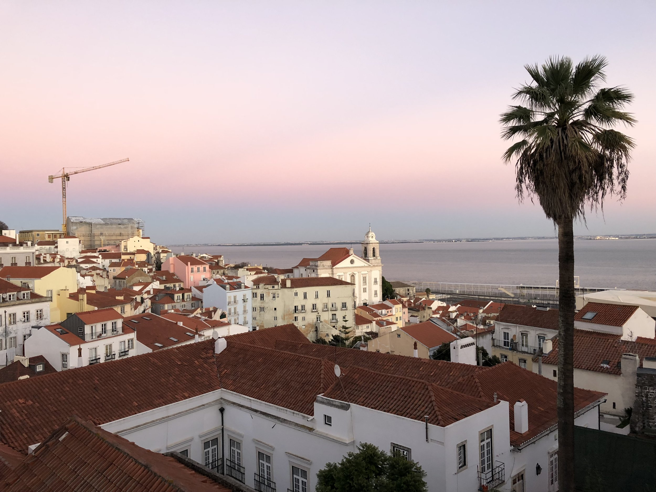 The sun beginning to set on the Tagas River in Lisbon.