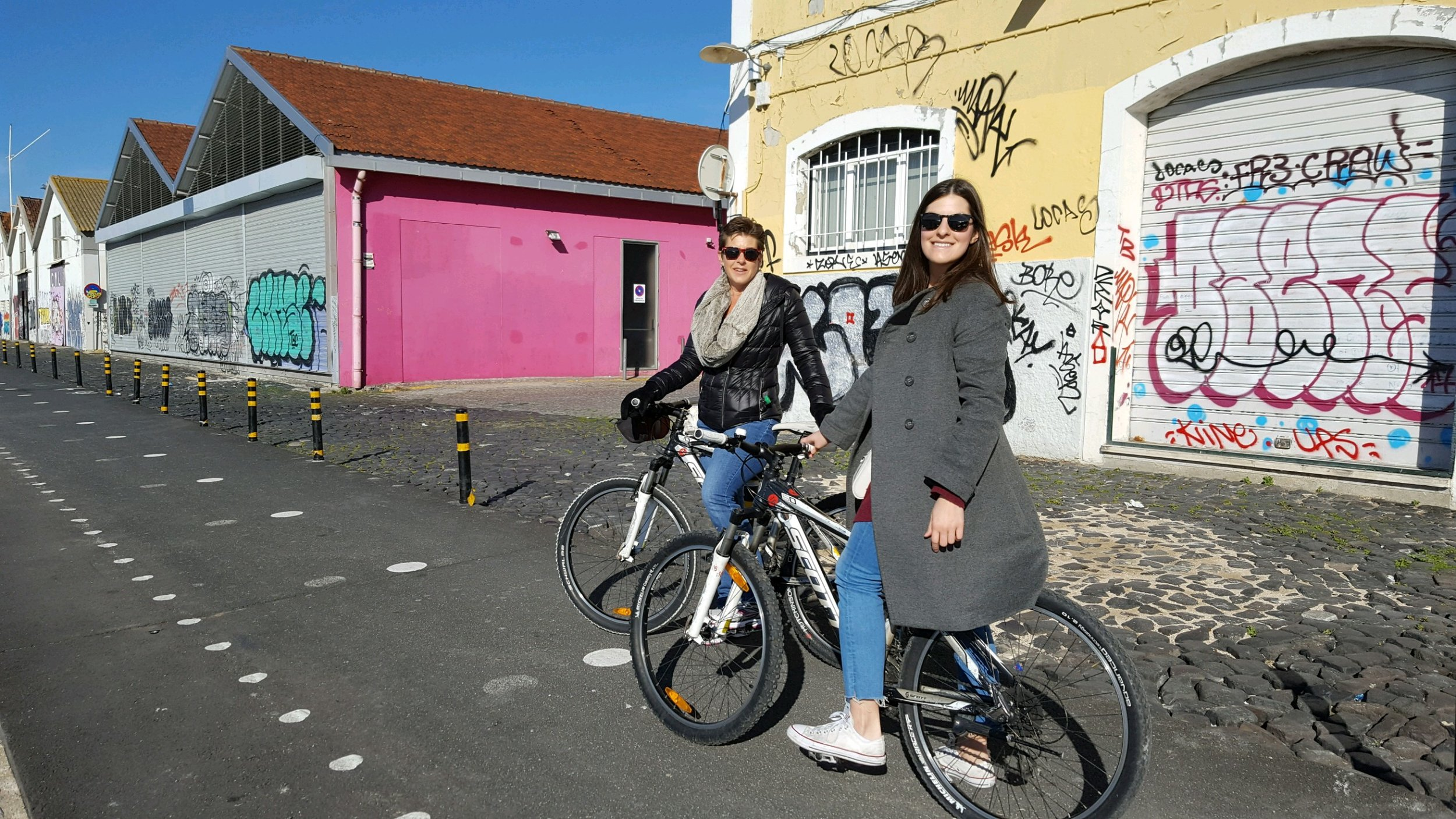 Biking in Lisbon! Definitely didnt need this heavy or long of a jacket.