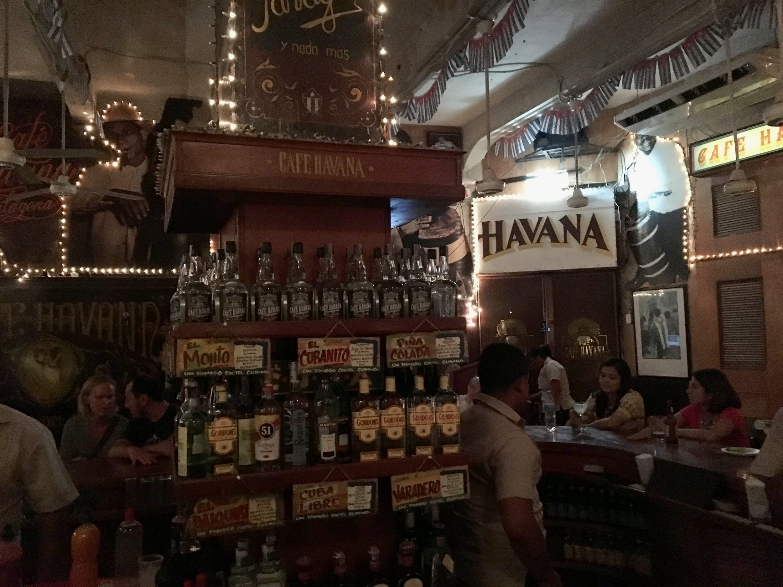 The very well-stocked bar at Cafe Havana (note the drink recipe cards!).