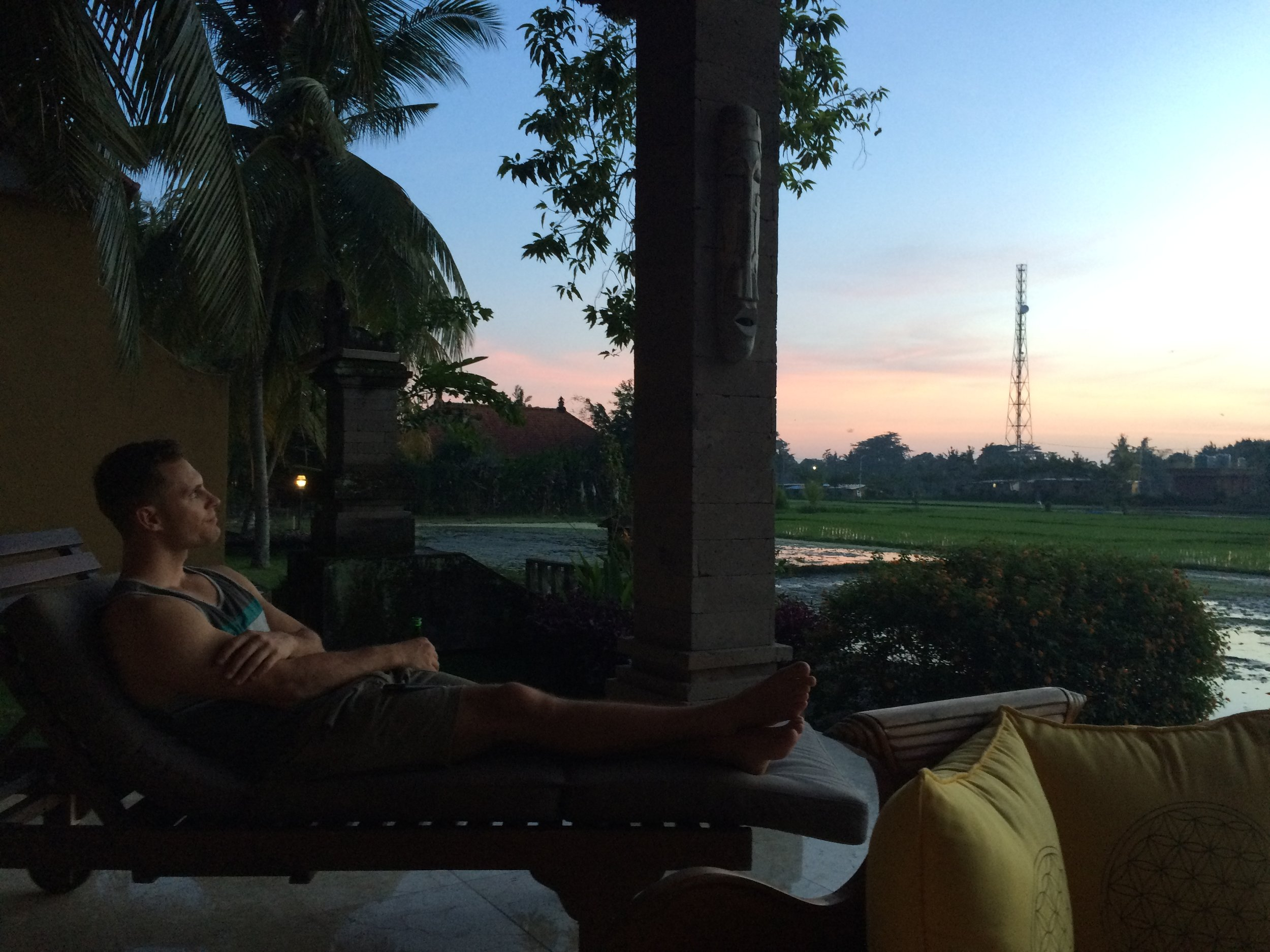 Enjoying the sunset on our private back patio overlooking more rice fields. Heaven.