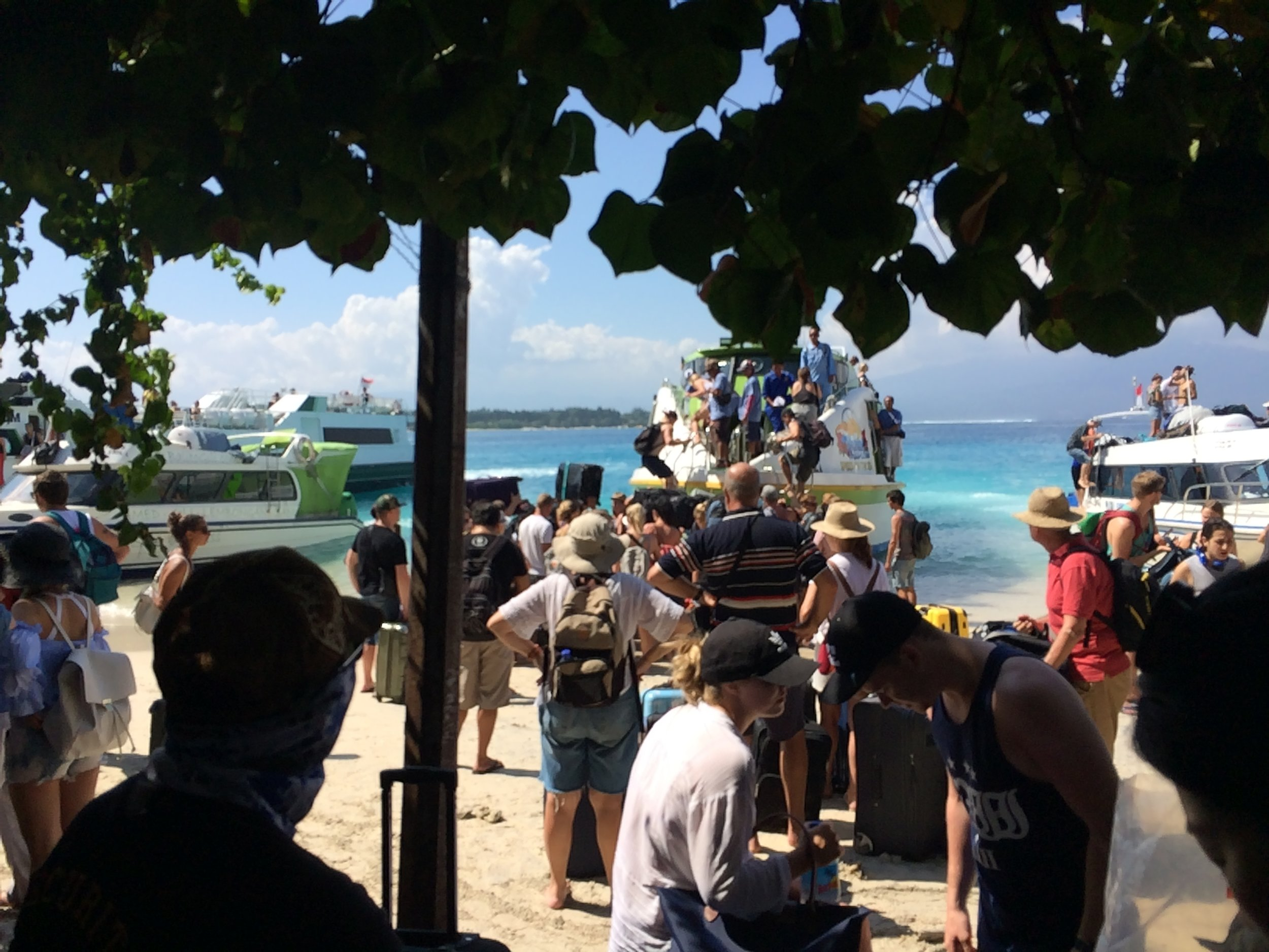 Lining up to get back on our speed ferry -- this time, to Padang Bai!