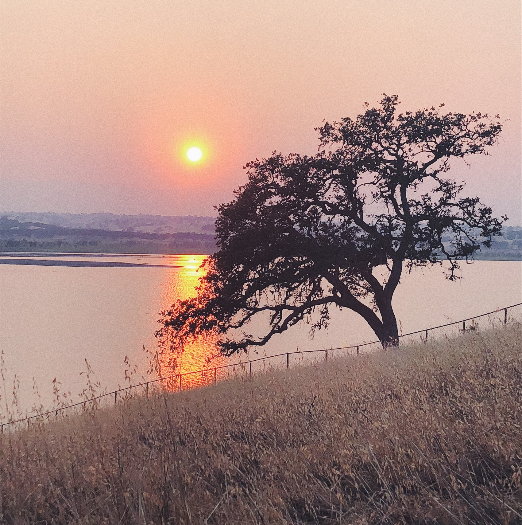 The sun setting over the lake at Orland Buttes.
