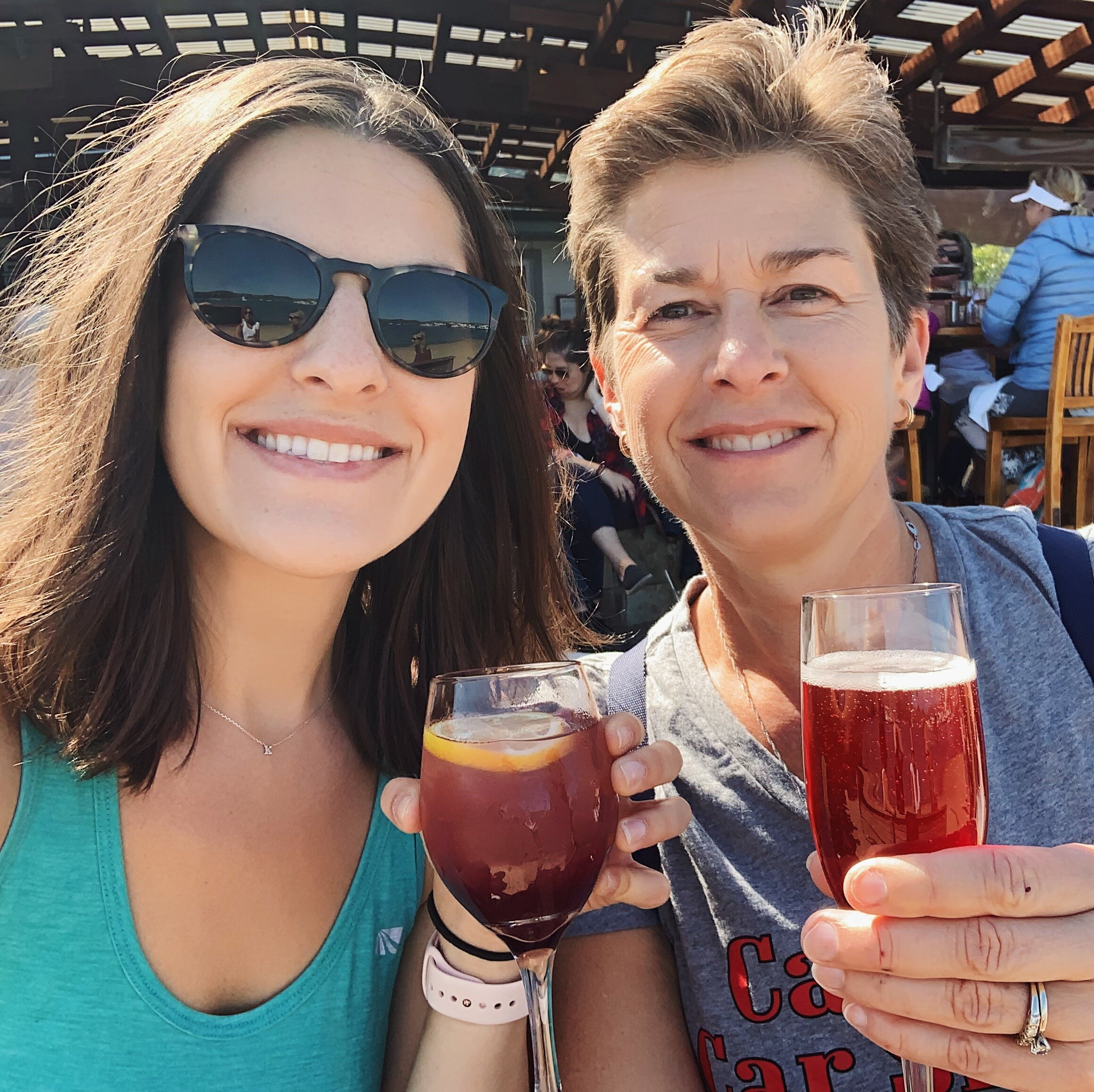 Mom and I sharing drinks on the beach after biking the Golden Gate to Sausalito.