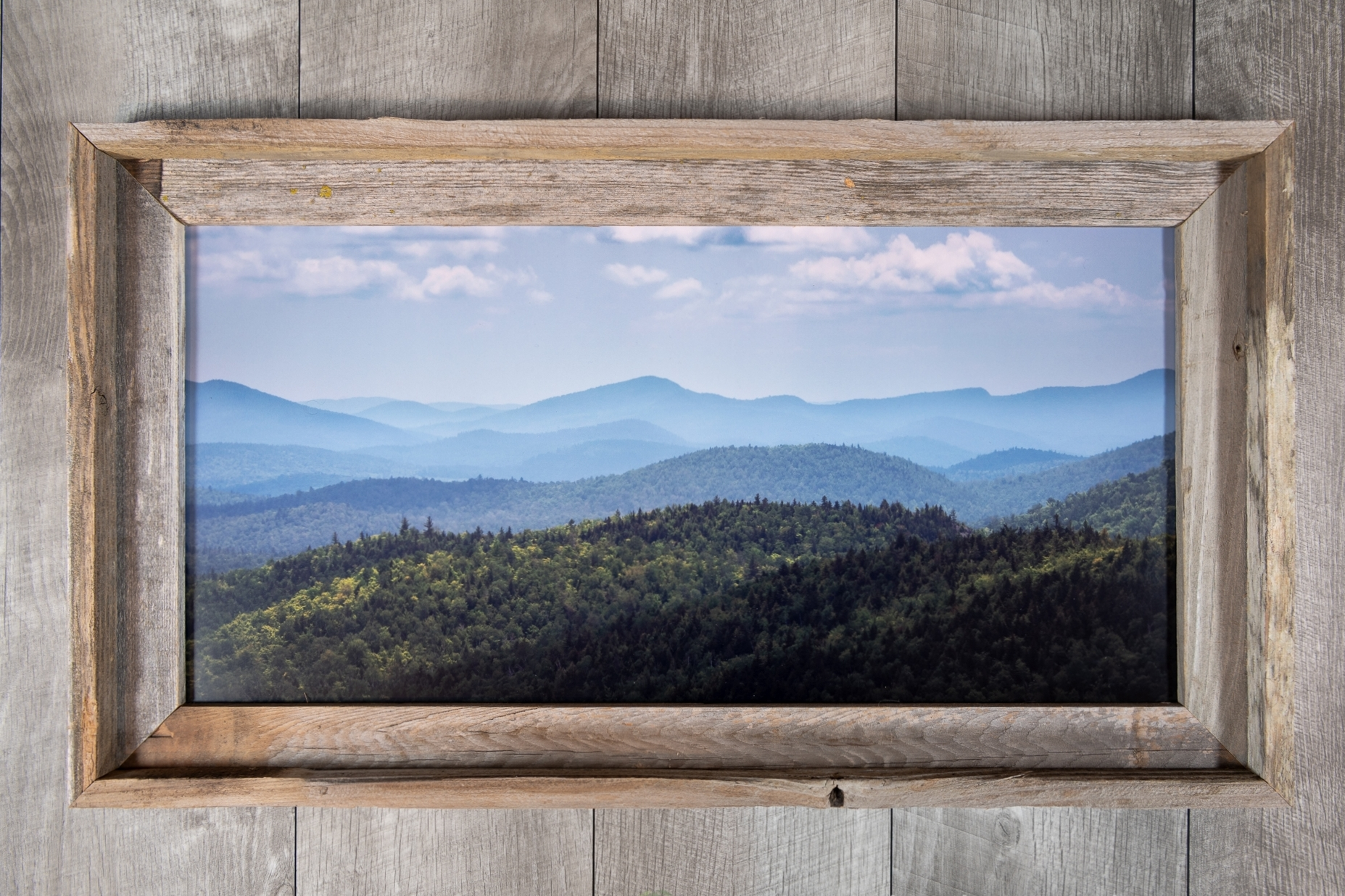 Limited edition photographs framed in 100% recycled barnwood that also give back to nature!