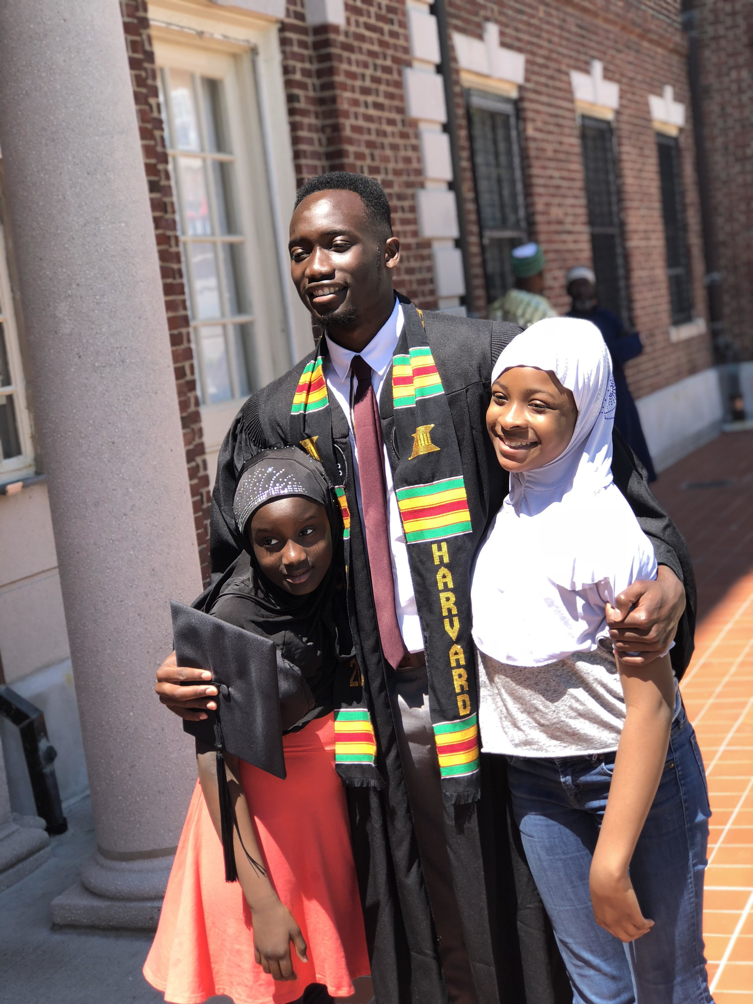 Nuha with his younger sisters at Harvard's commencement.