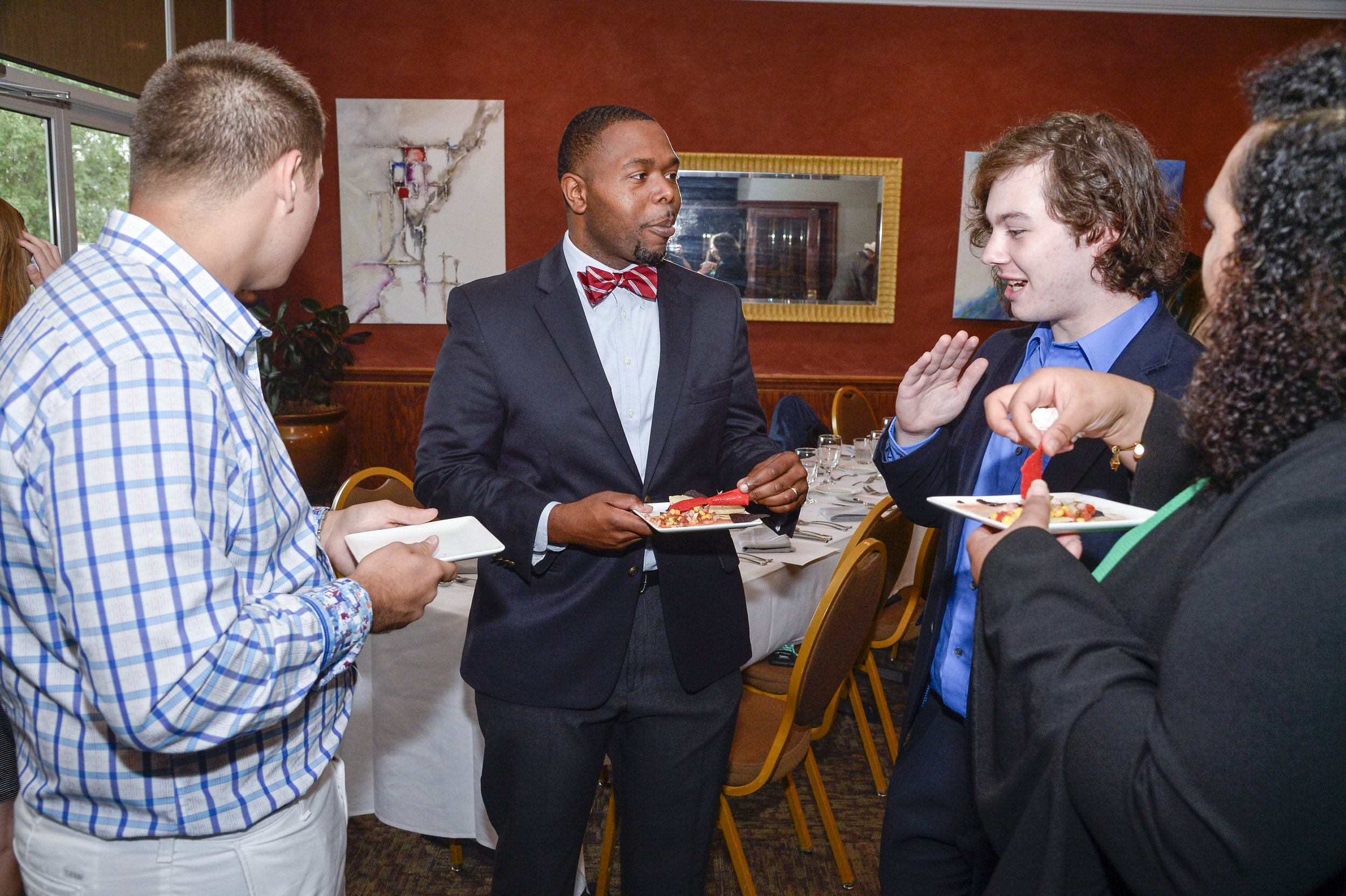 James with students at Wofford College during a business etiquette event.