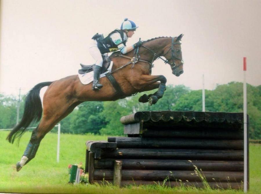 Sophie was an athlete in college. Here she is at an     eventing     competition.