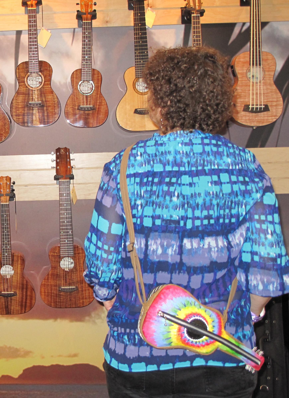 becky posing guitar namm ukes.jpg