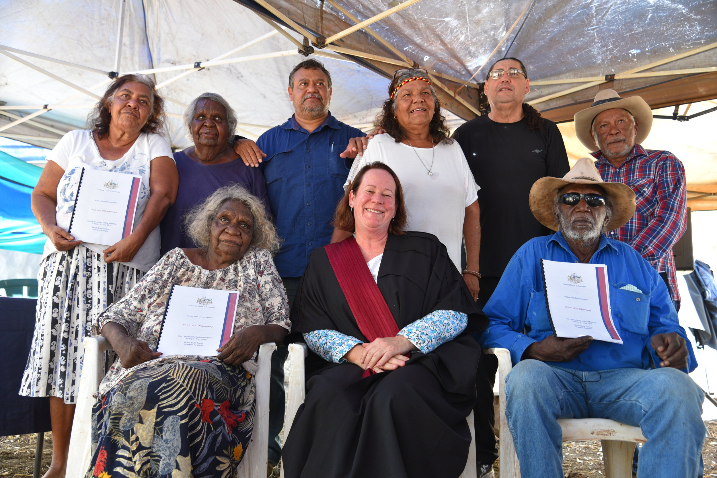 Members of the Ngarrawanji Applicant (from back left) Josie Sarah, Jennifer Tait, Greg Tait, Josie Farrer, Mark Bin Baker, Marty Stevens (front left) Phyllis Wallaby, Justice Mortimer and Matt Dawson.