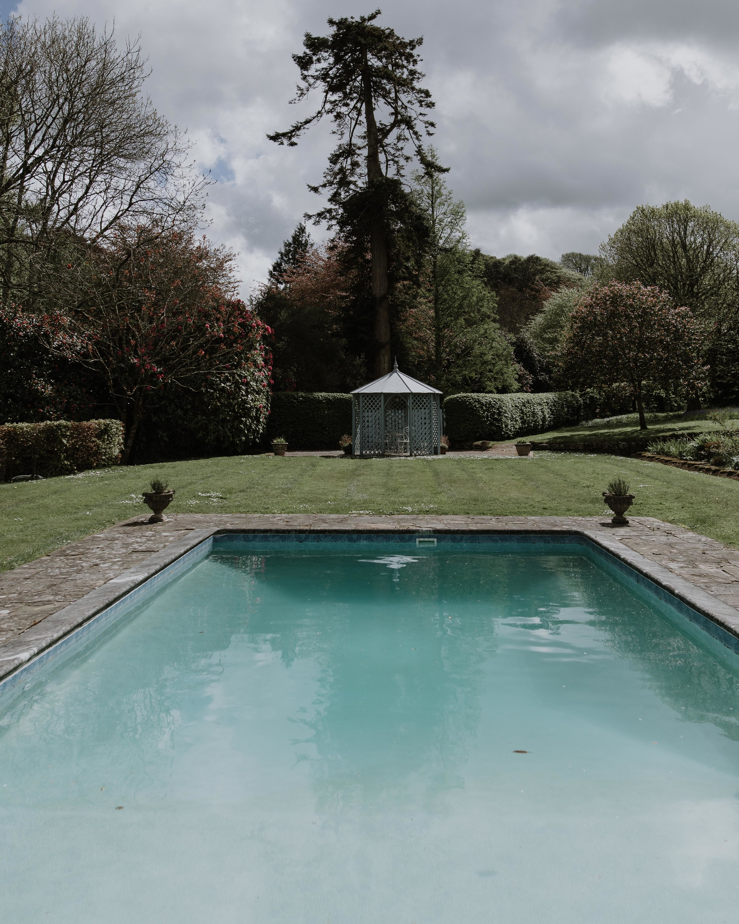 Outdoor Pool - Wedding day photograph at Scorrier House Cornwall