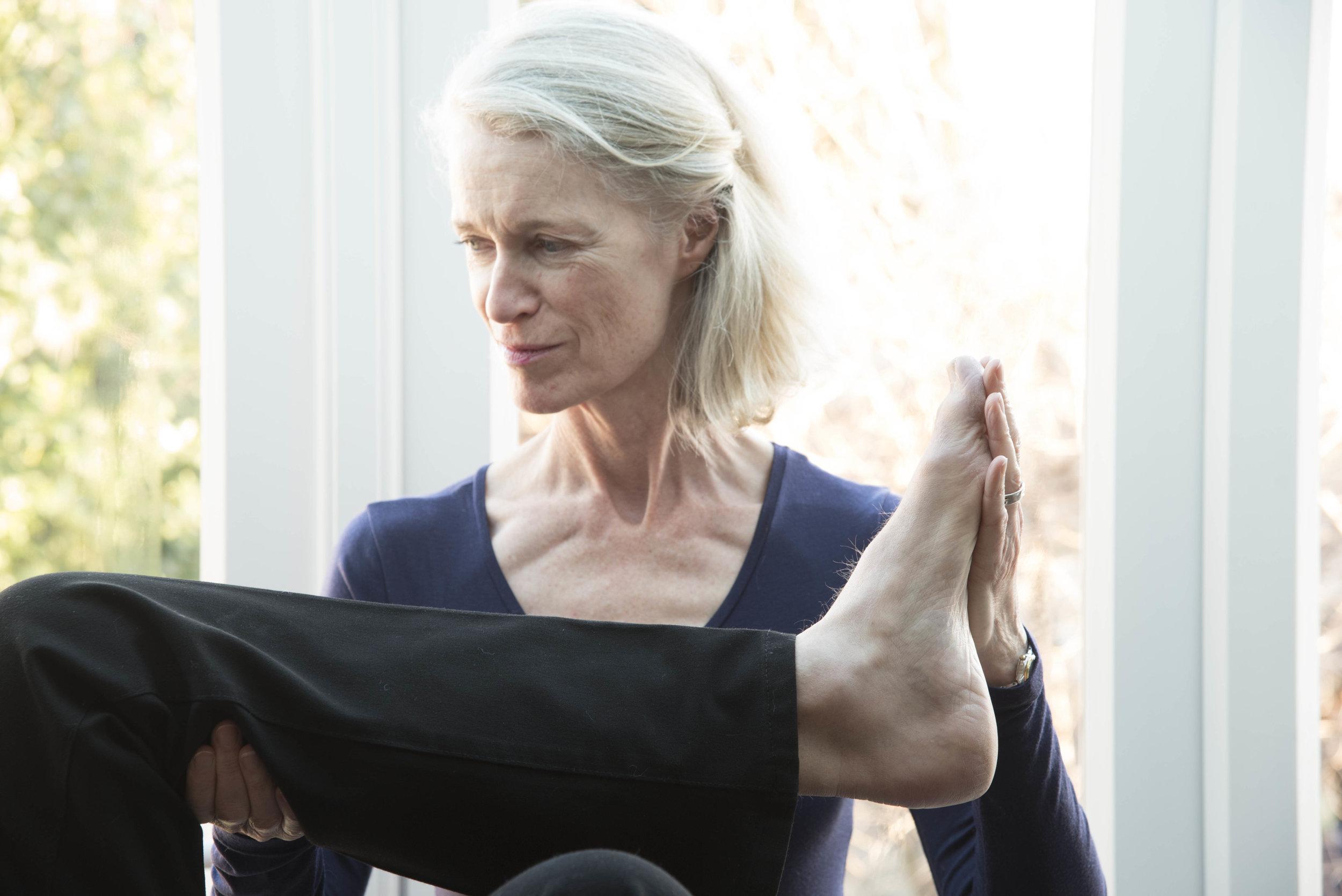 East Sussex Alexander Technique Teacher Kate Minogue holding a foot.jpg