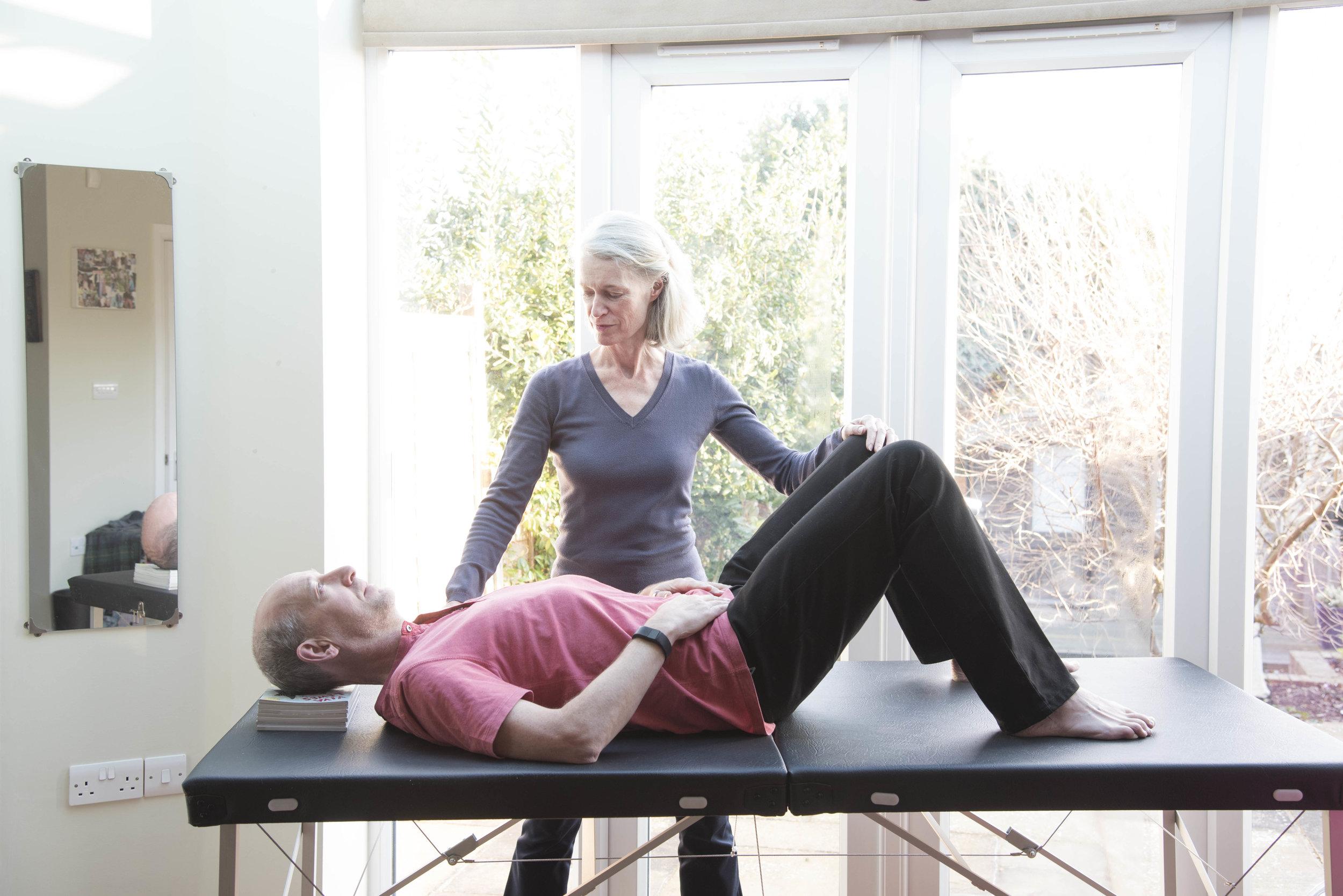 Older woman teaching Alexander Technique to man.jpg