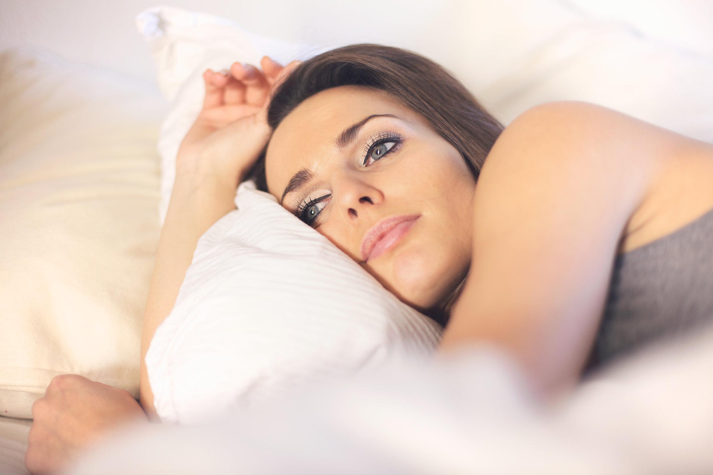 woman with poor or bad sleep habits or hygiene.jpg