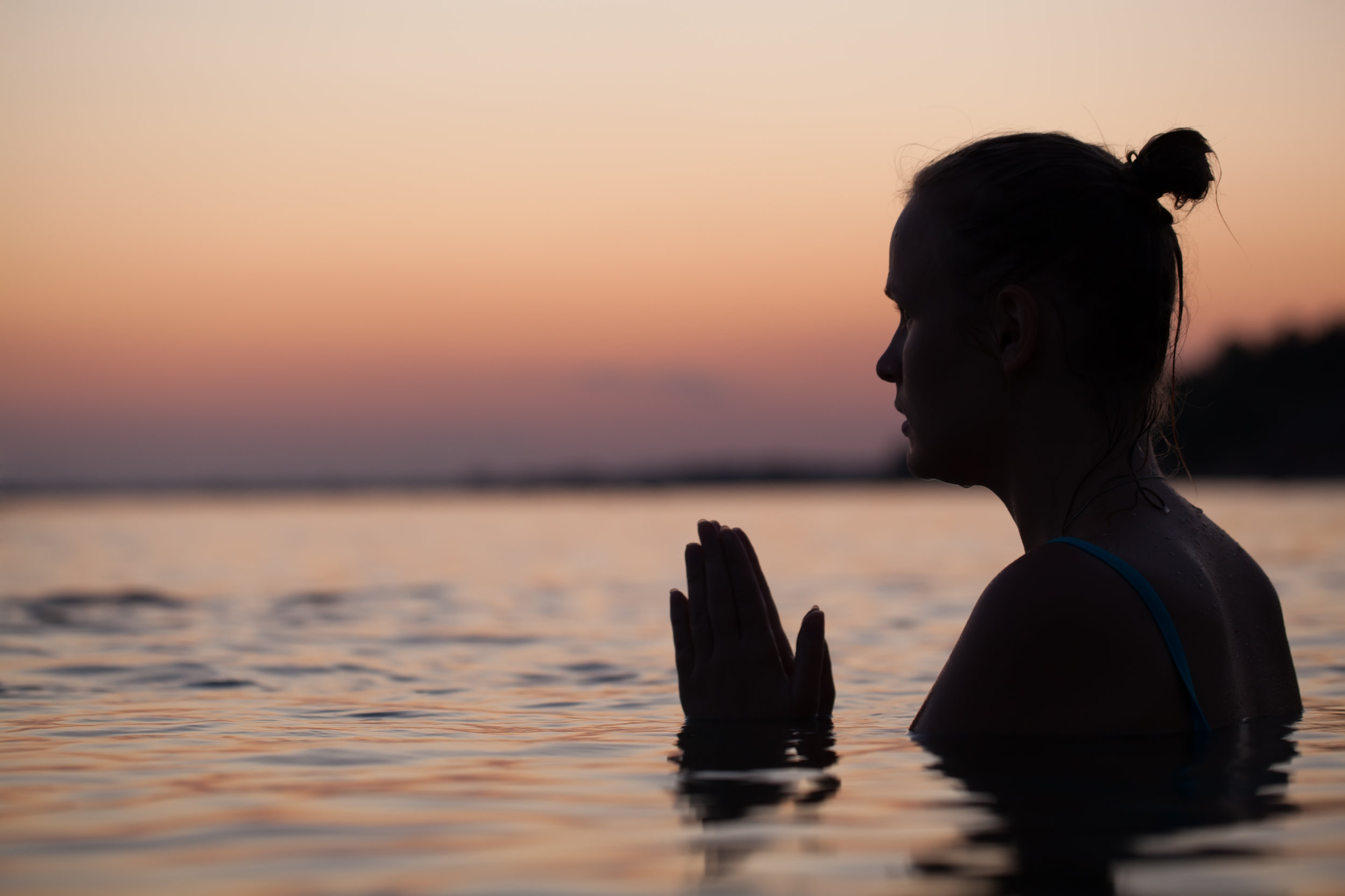 physically relaxed woman in water as part of physical self-care.jpg