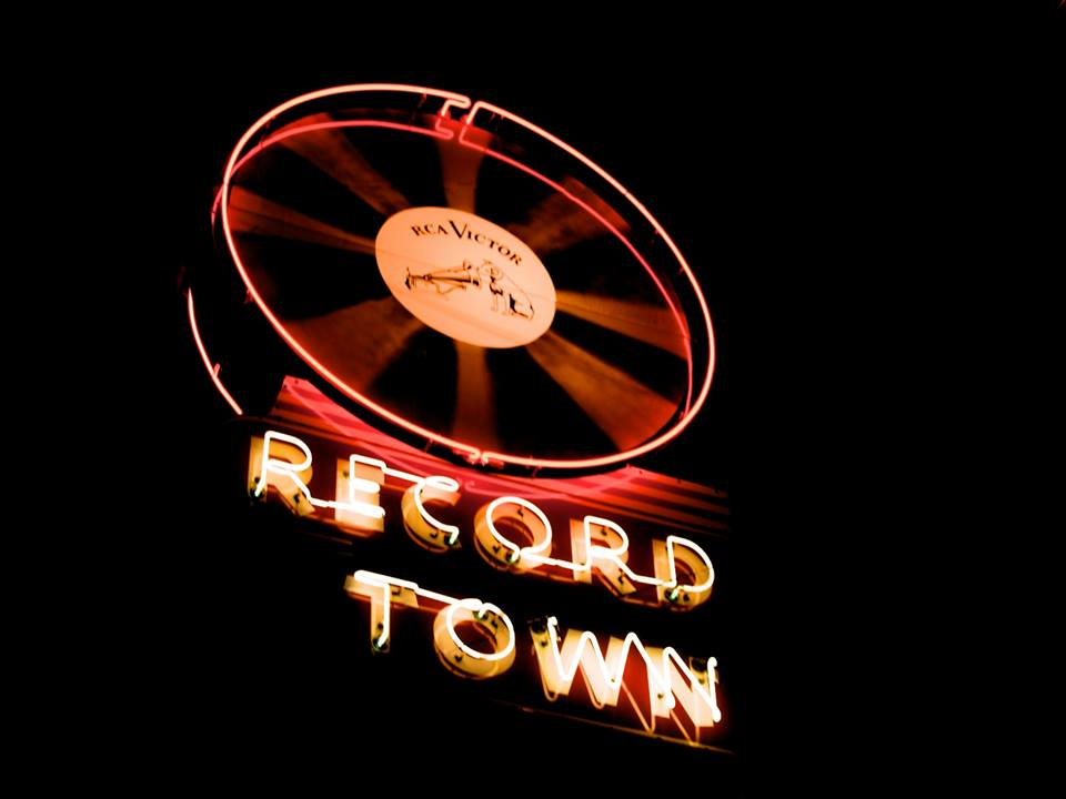 Record Town Neon Sign at Night.