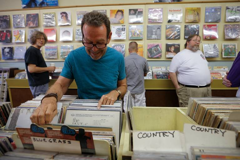 Jack Hartsfield, of Fort Worth browses the bins for music old and new as Record Town closes its location on University Drive and will relocate south of downtown, Saturday, May 26, 2018. Rodger Mallison Fort Worth Star-Telegram