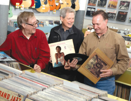 Left to right: Record Town owners Gerard Paul Daily, Tom Reynolds and Bill Mecke discuss some favorite LPs.