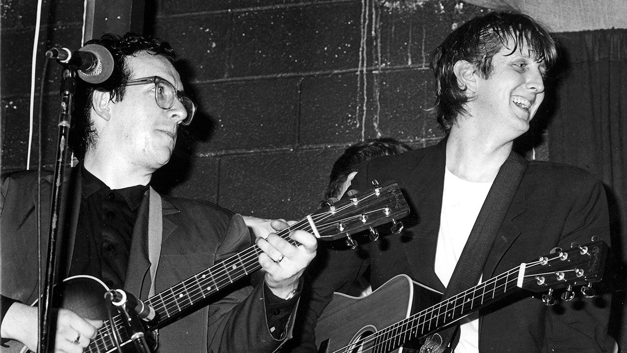 Burnett (right) with Elvis Costello (left) at McCabe's Guitar Shop, in Santa Monica, California, in 1984.