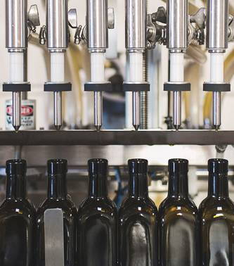 Bottles on a inline filling machine