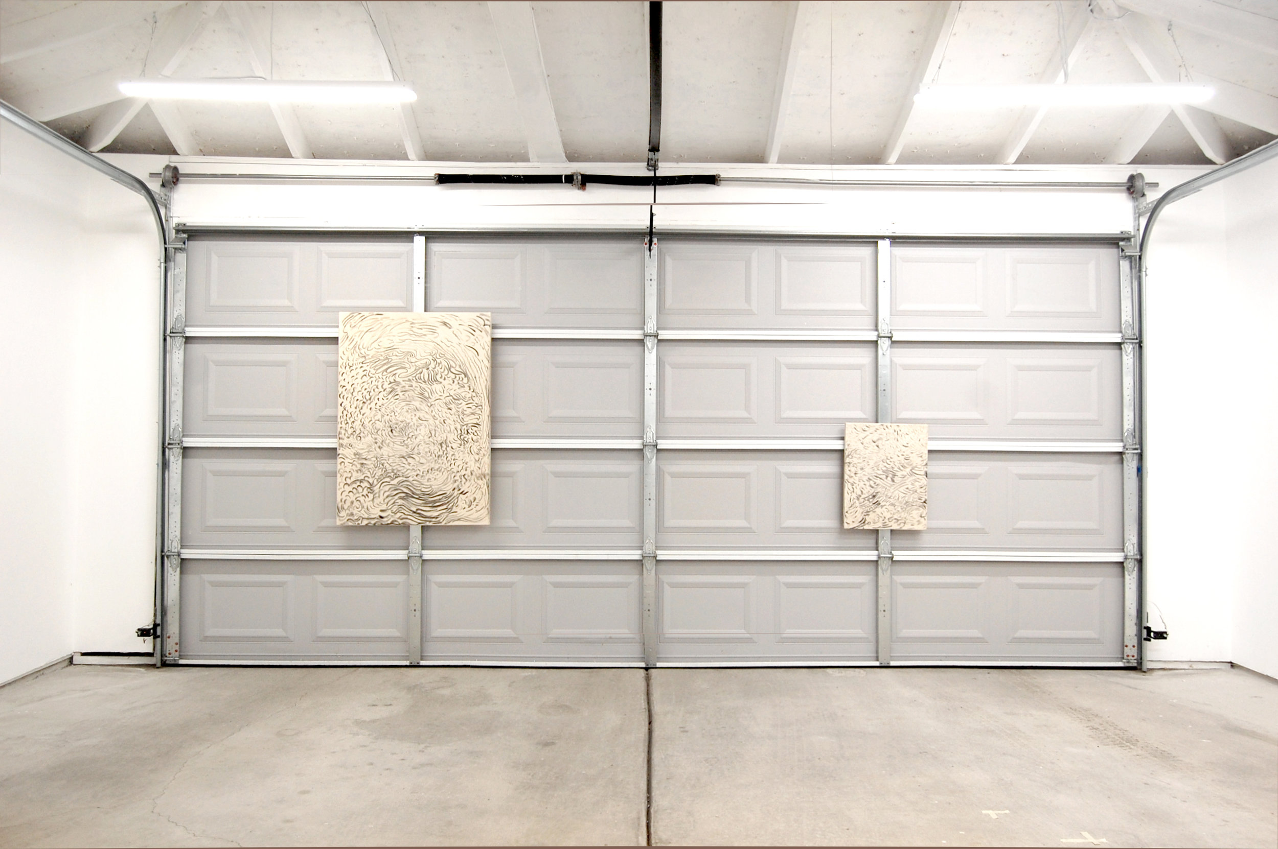Forced Autumn , installation view at Chicago Manual Style, 2017. Ricardo Morales-Hernández,  Fuego — SDG-017-002 , 2017, 30 x 40 inches, andViento  SDG-017-005 , 2017, 16 x 20 inches, artist-made charcoal on canvas.