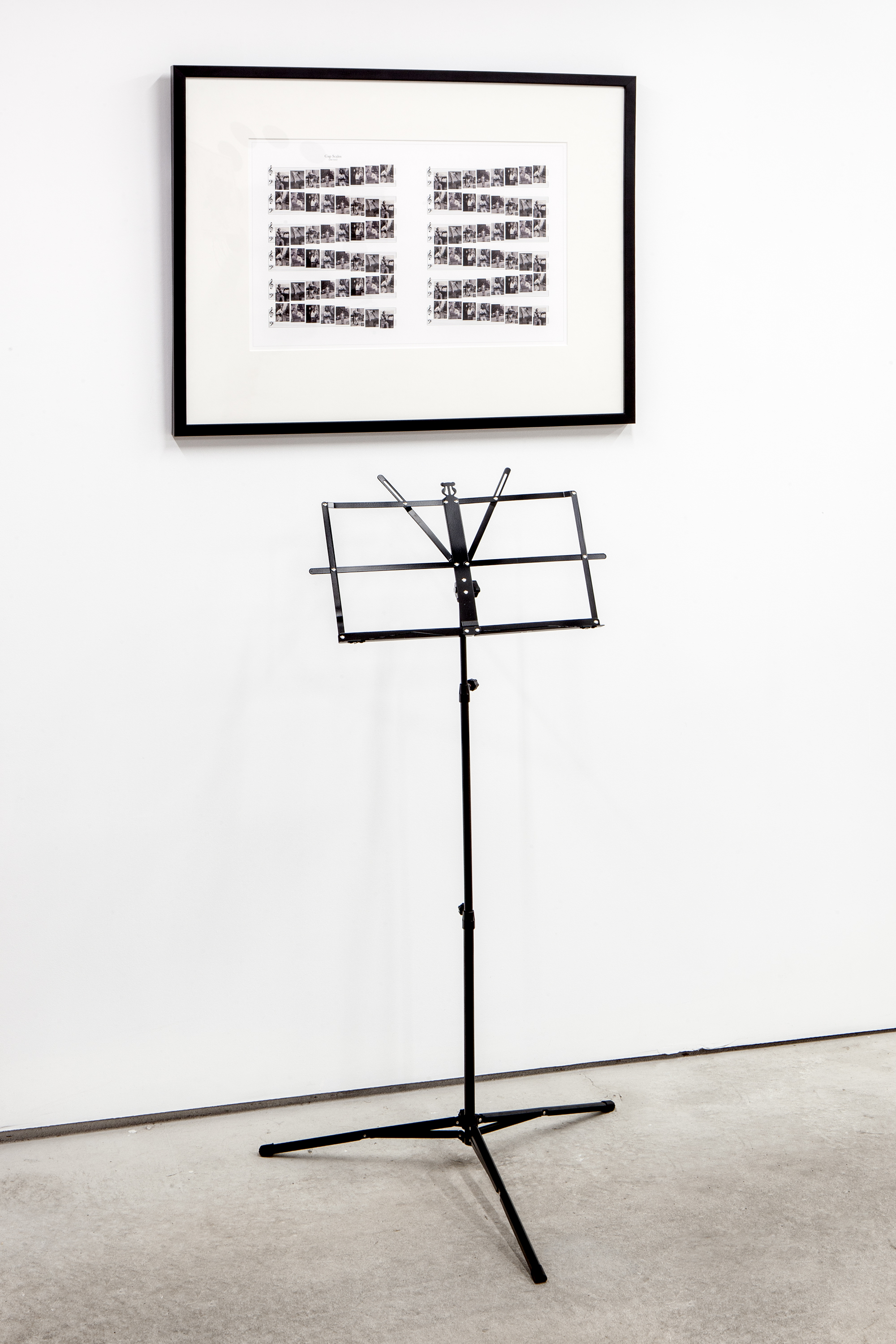 Barbara Bloom (b. Los Angeles, California, 1951),  Song: Gap Scales (me too) , 2008. Archival digital print and music stand. Framed Dimensions: 24 x 30 inches (variable for stand placement). Edition AP 1 of 2. Courtesy David Lewis Gallery, New York. Photo:Daniel Hojnacki.