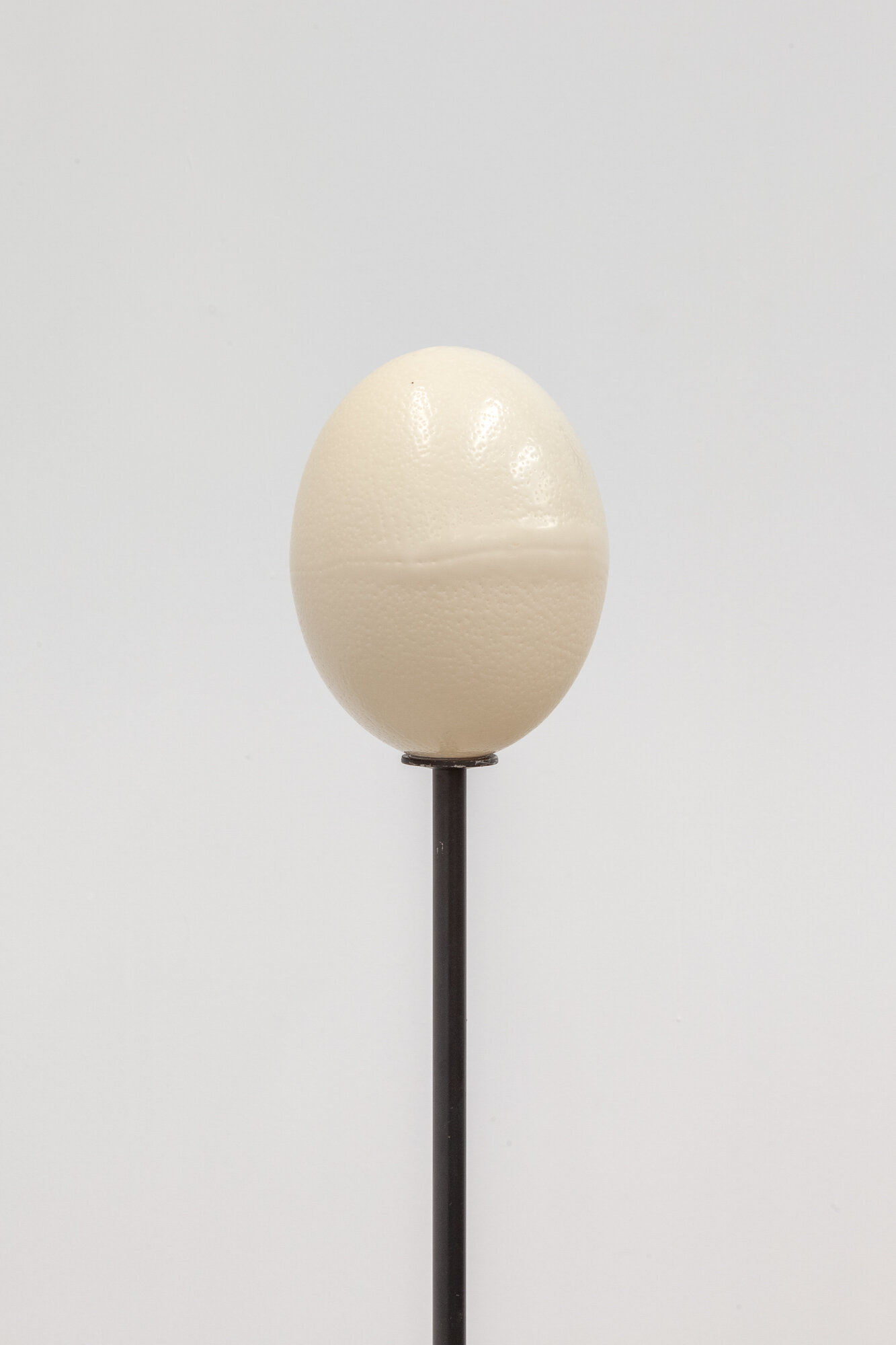 Image: Sarah Ortmeyer,  ROI , 2019. Ceramic egg with metal stand.  INFERNO CHICAGO , curated by Stephanie Cristello, Chicago Manual Style (Chicago, IL). Copyright Sarah Ortmeyer. Courtesy of Dvir, Tel Aviv / Brussels. Photographer: Robert Chase Heishman.