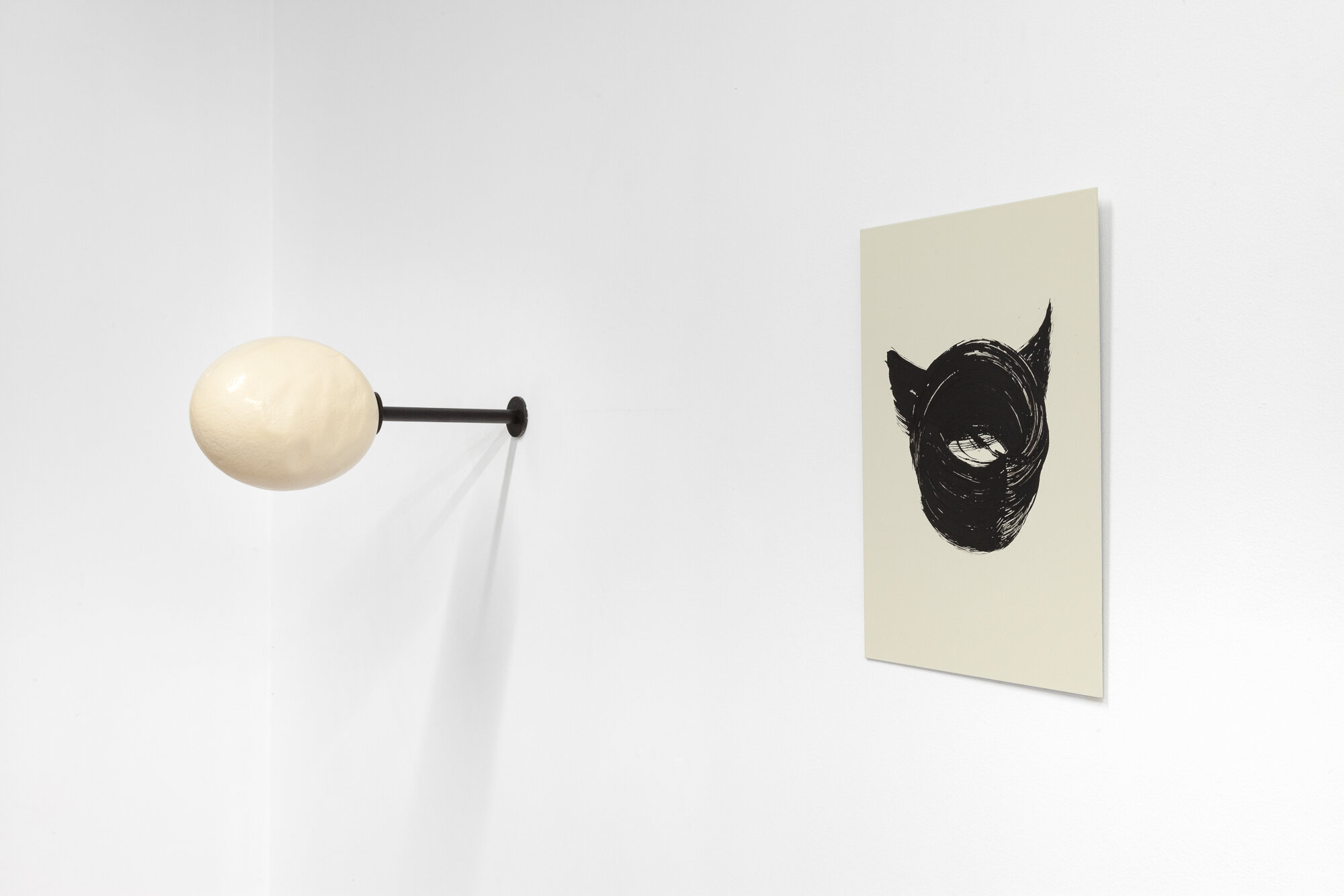 Image: Sarah Ortmeyer,  PION  and  DIABOLUS , 2019. Ceramic egg with metal stand / Gesso on metal.  INFERNO CHICAGO , curated by Stephanie Cristello, Chicago Manual Style (Chicago, IL). Copyright Sarah Ortmeyer. Courtesy of Dvir, Tel Aviv / Brussels. Photographer: Robert Chase Heishman.