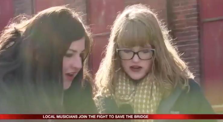"Julie VonVolkenberg, and student Erin, sing ""Save Your East Avenue Bridge."""