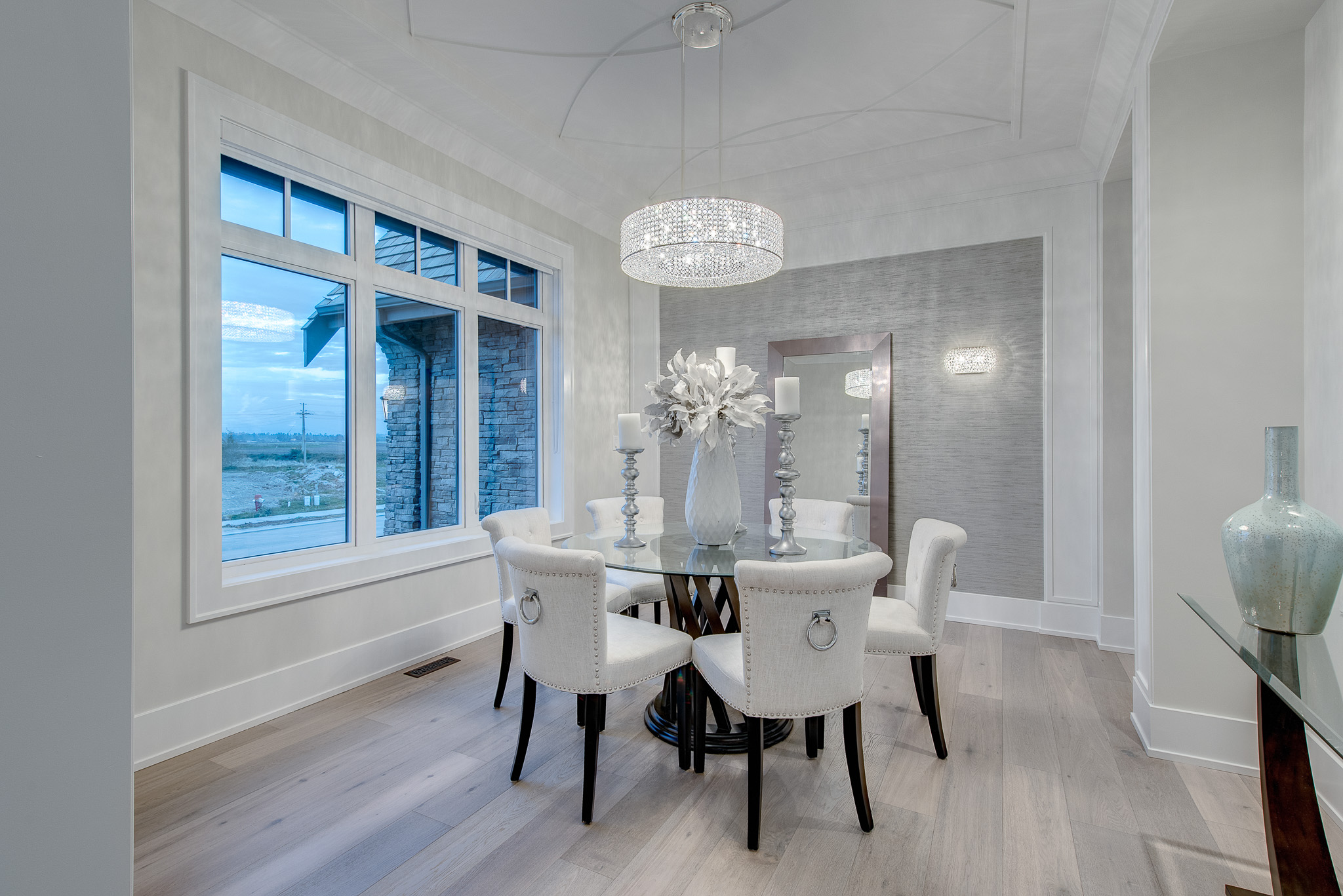 contemporary dining room with crystal chandelier