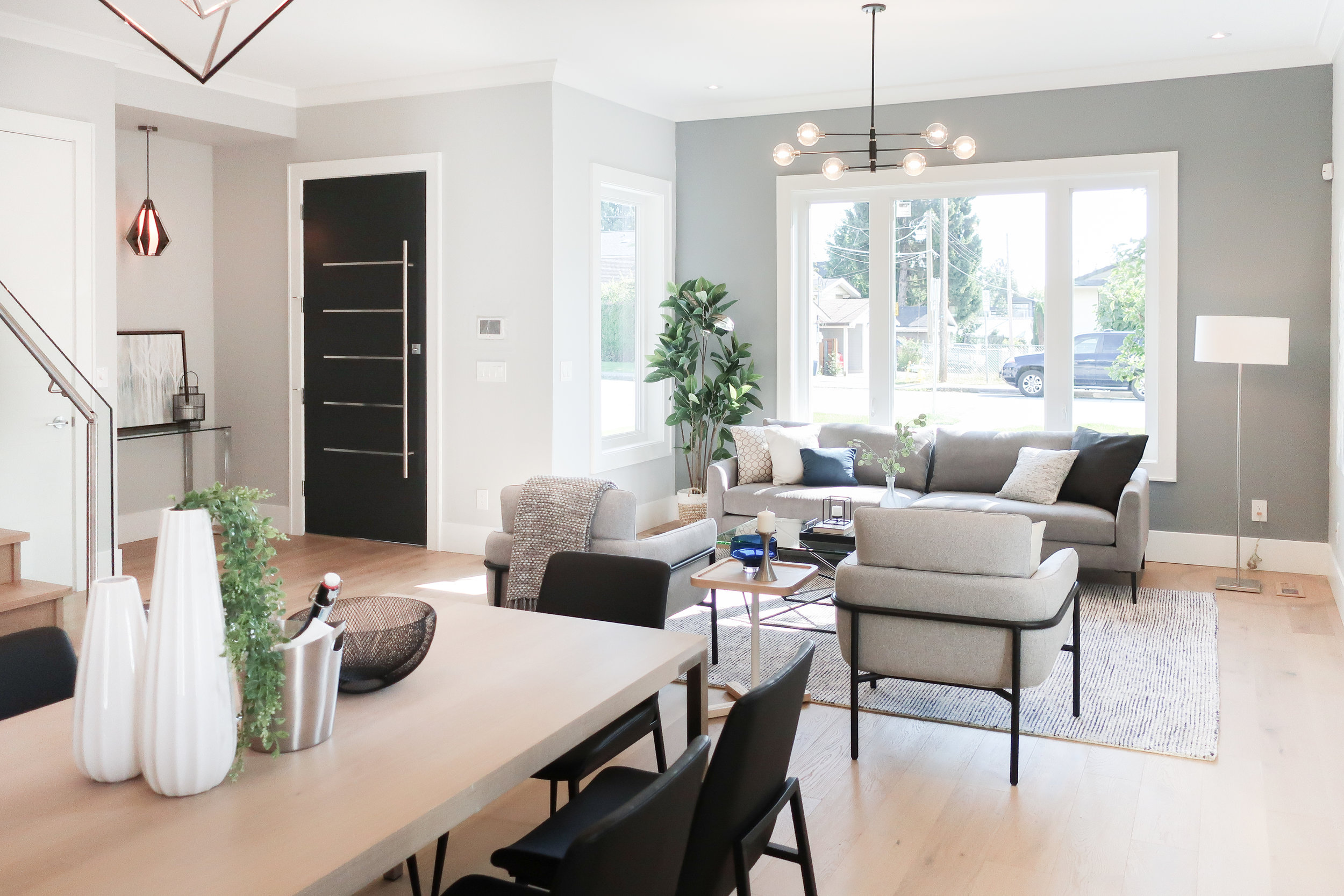 contemporary living room with black pendant light