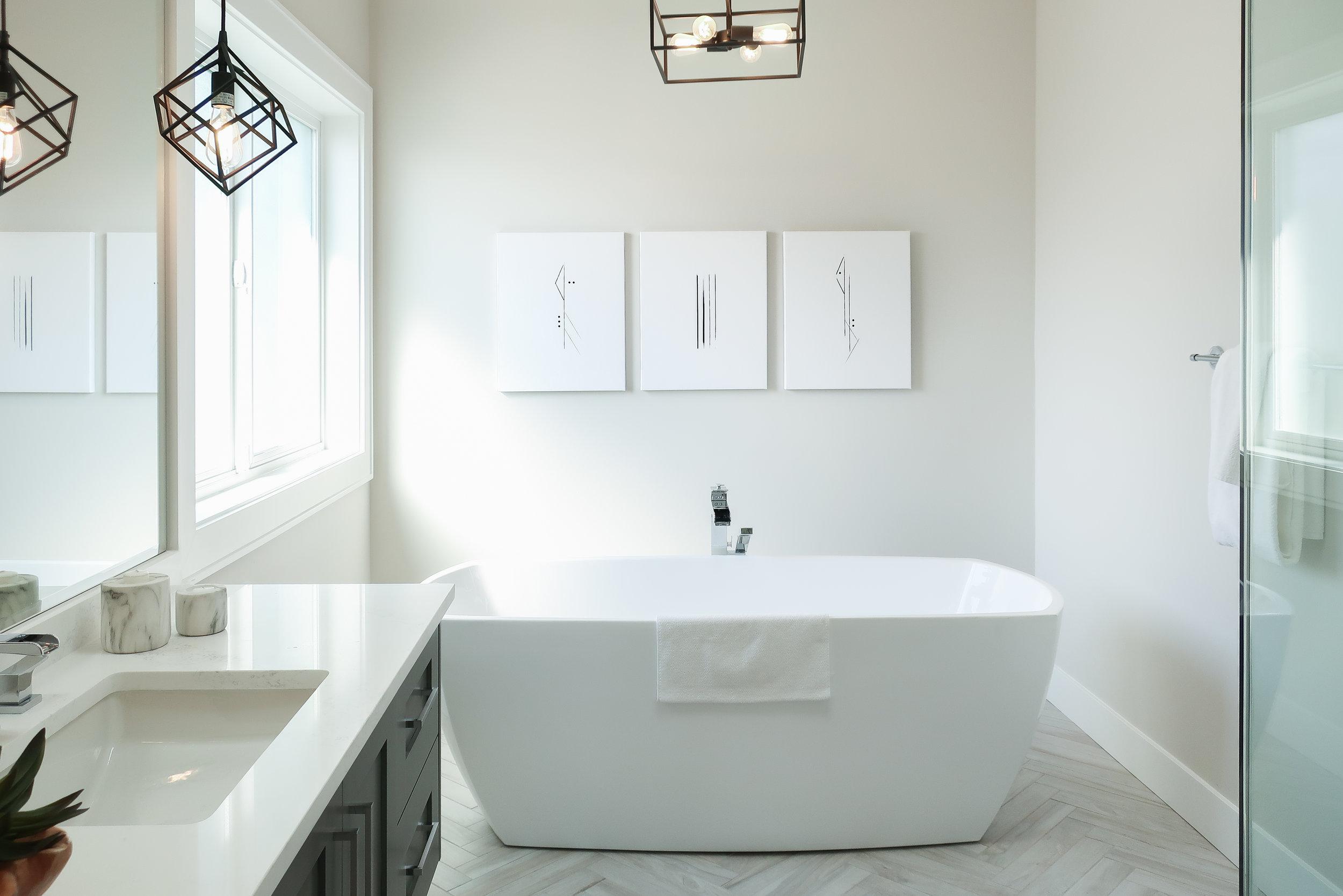contemporary bathroom with black light pendants