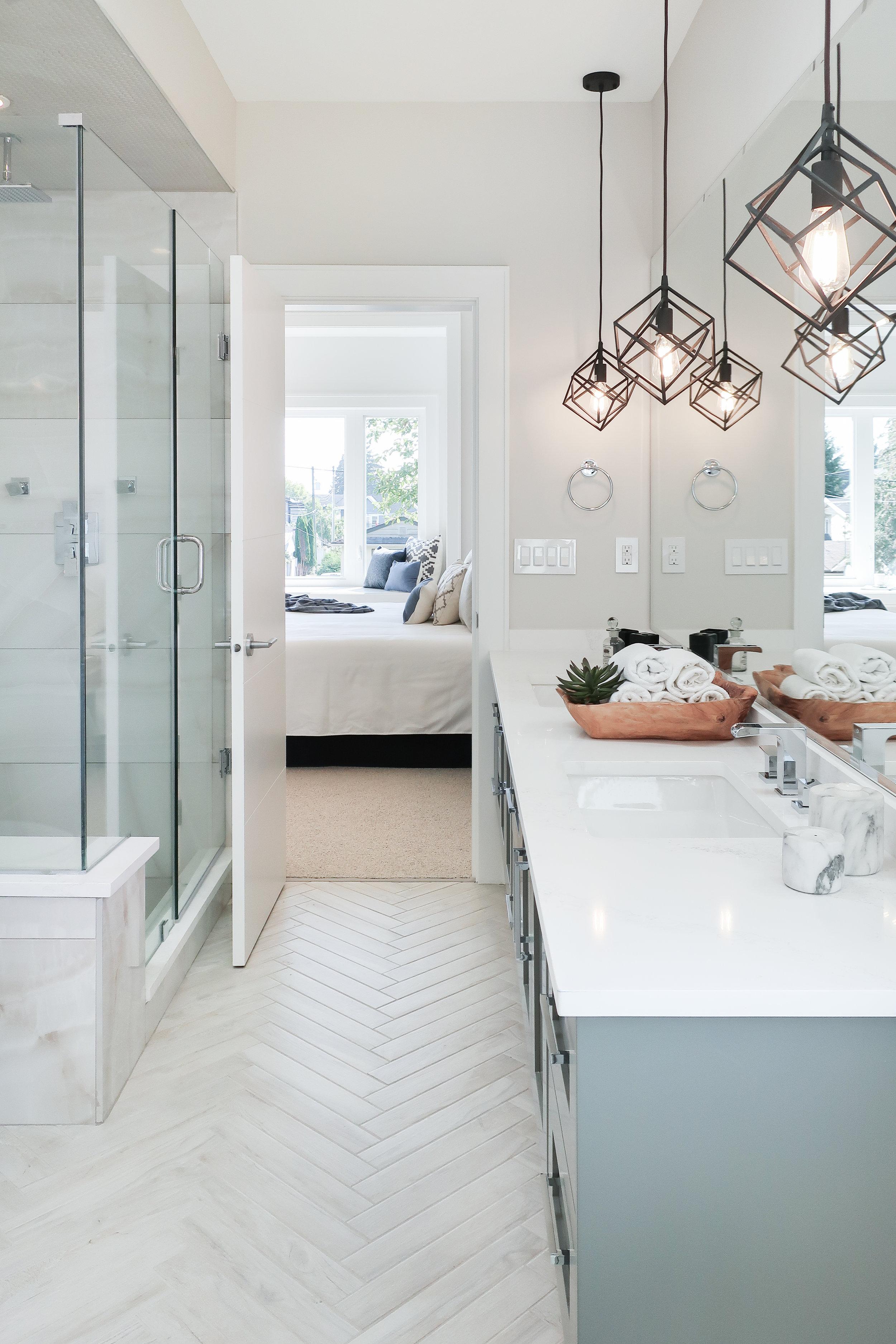 master bath vanity with black pendant lights